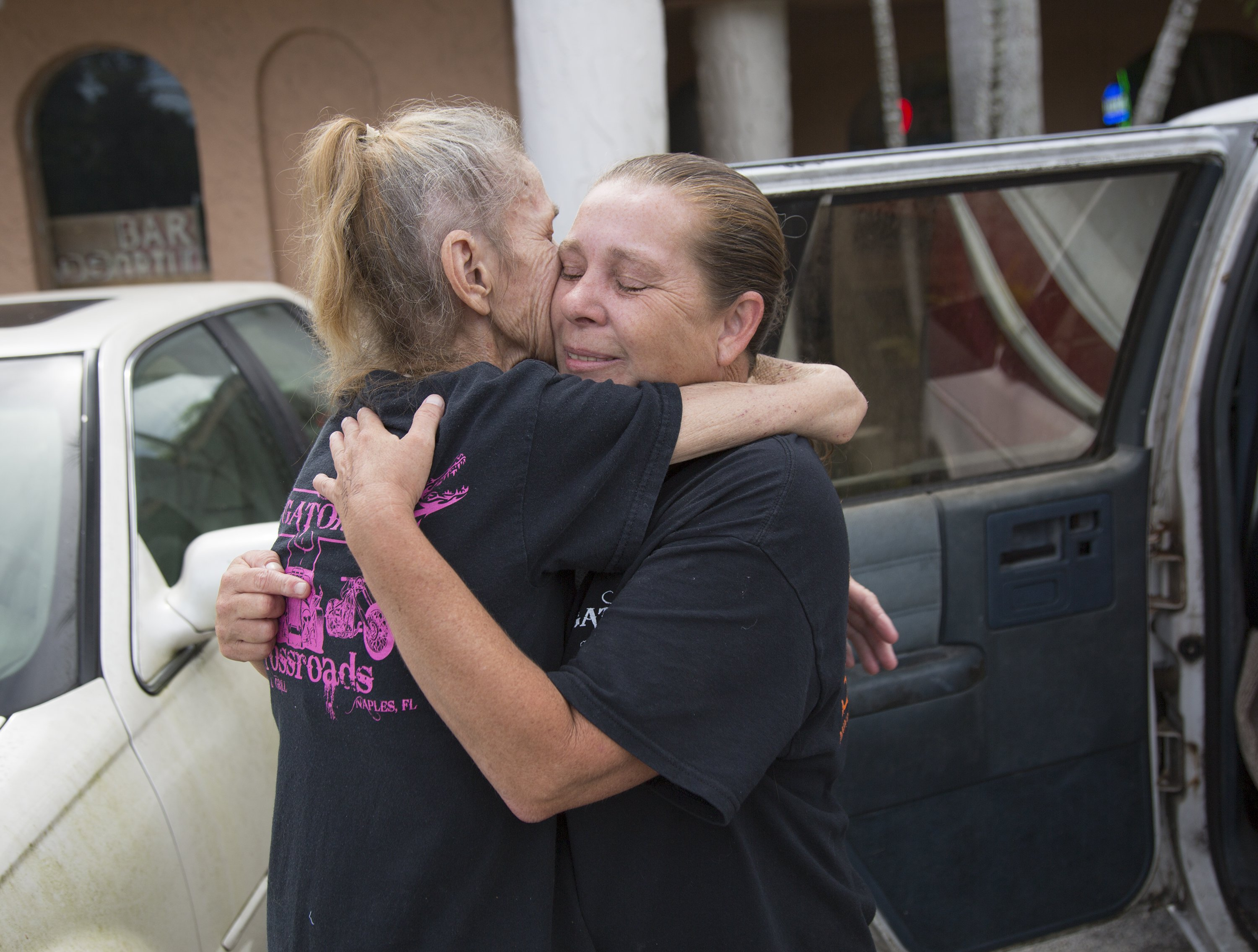Image: Gator's Crossroads owner Linda Pauly, right, embraces cook Candy Canfield outside the bar before saying goodbye on Friday, Sept. 8, 2017 in Collier County, Florida.