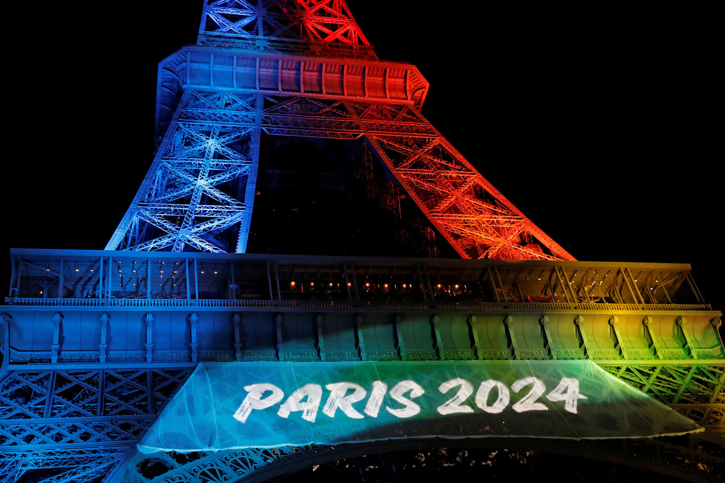 Image: The Eiffel Tower is Lit in the Colors of the Olympic Flag