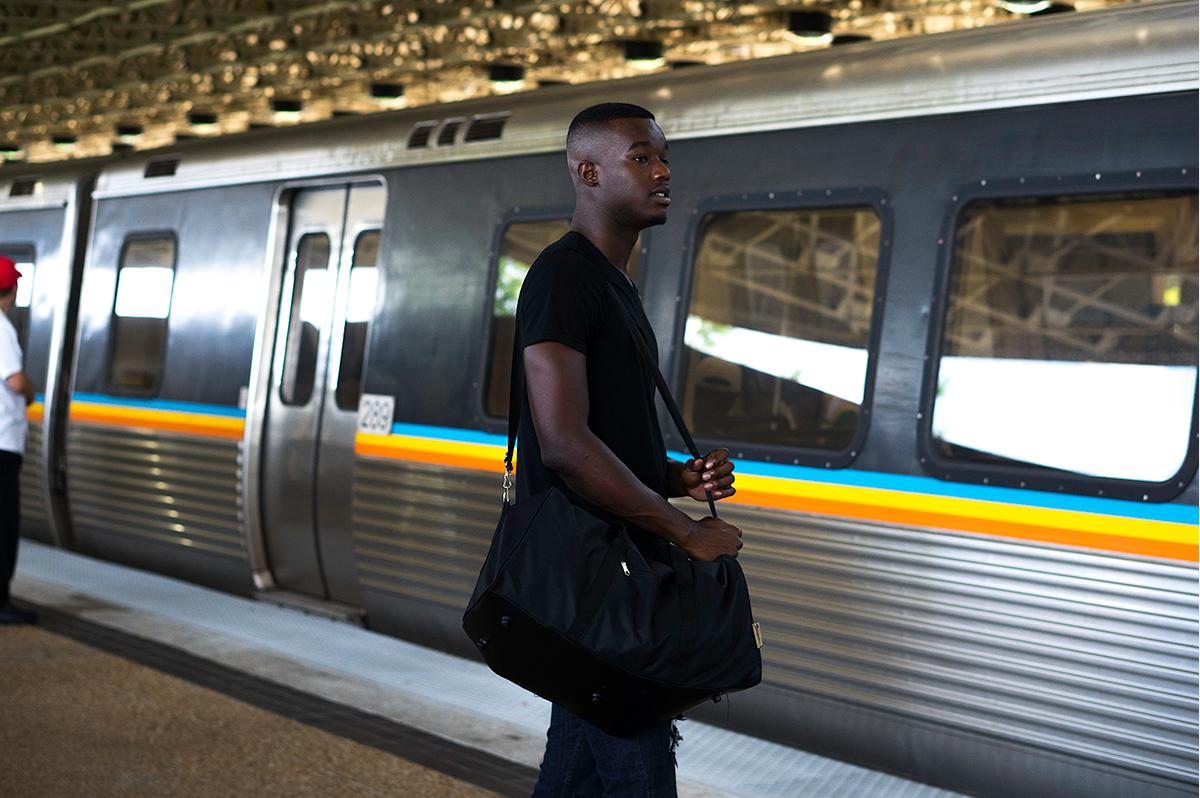 Image: BRWN Stock Image, man waiting for train