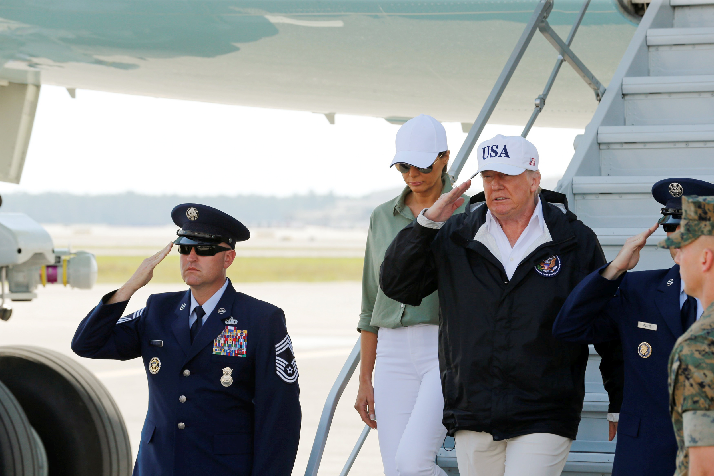 Image: U.S. President Trump steps off Air Force One prior to receiving a a briefing on Hurricane Irma relief efforts in Fort Myers, Florida