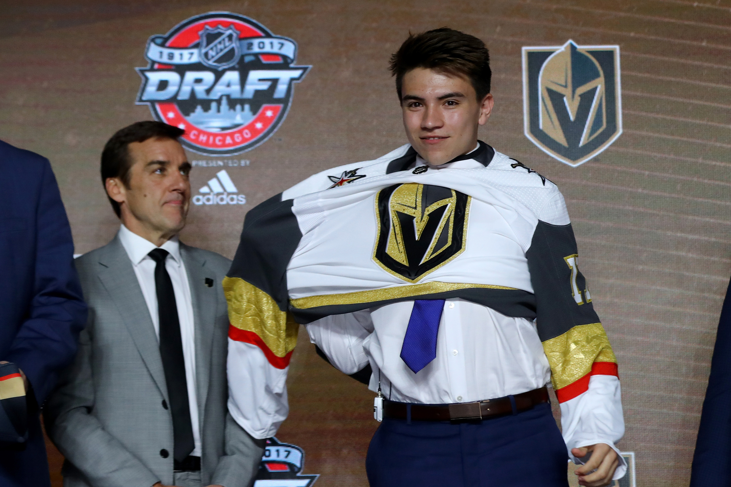 Image: Nick Suzuki puts on the Vegas Golden Knights jersey during the 2017 NHL draft