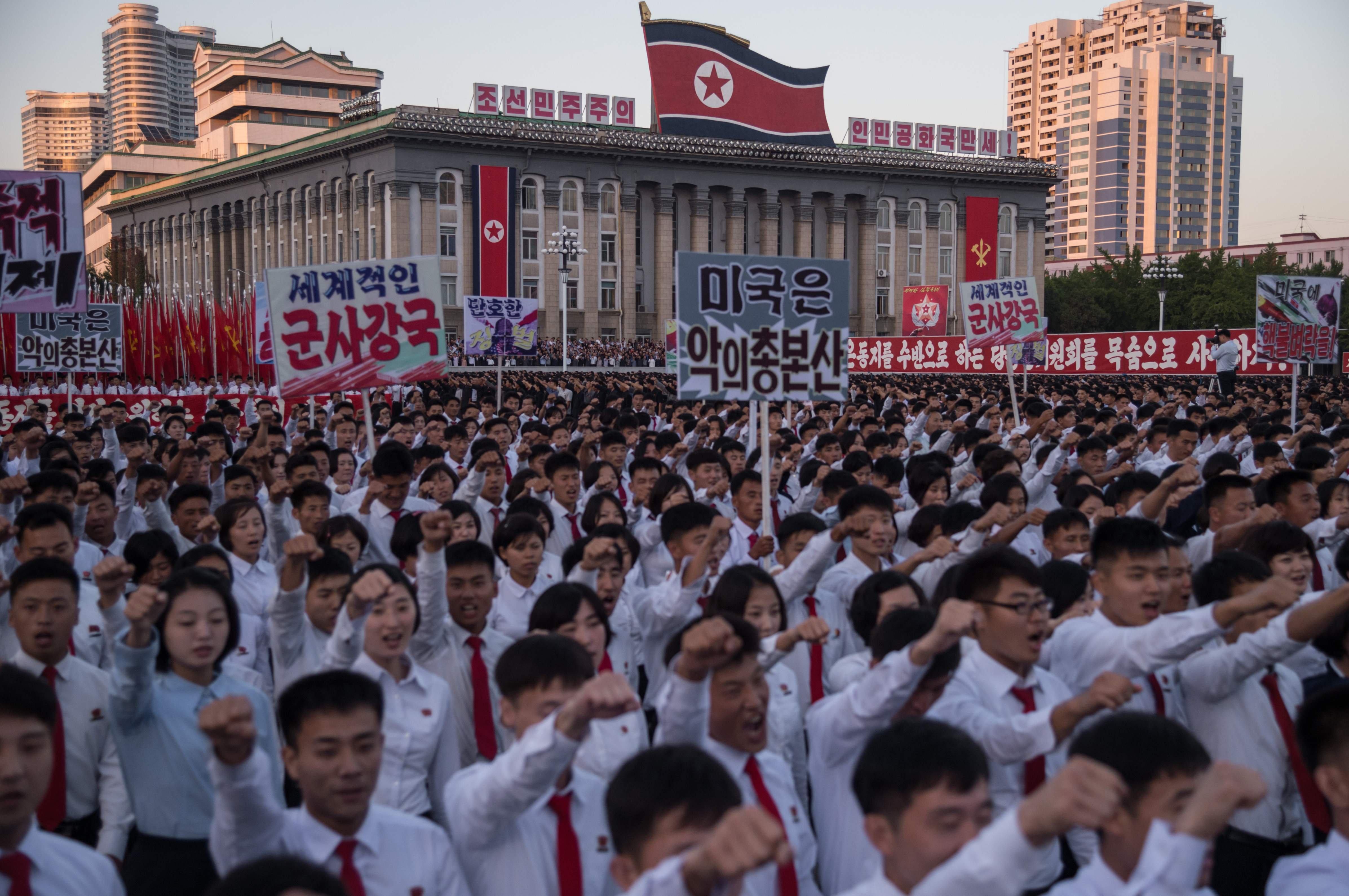 Image: North Koreans at mass rally