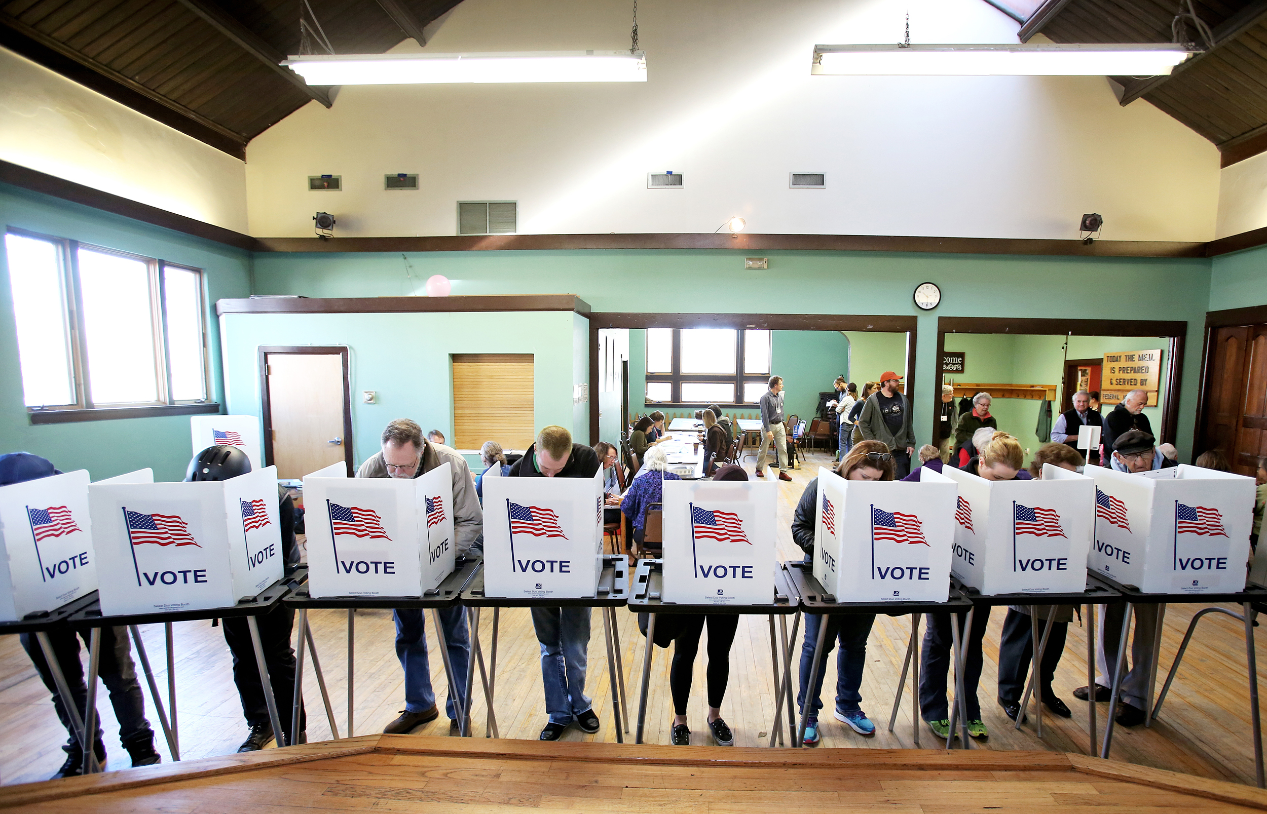 Image: Voters cast their ballots at the Wil-Mar Neighborhood Center on the Near East Side of Madison, Wisconsin