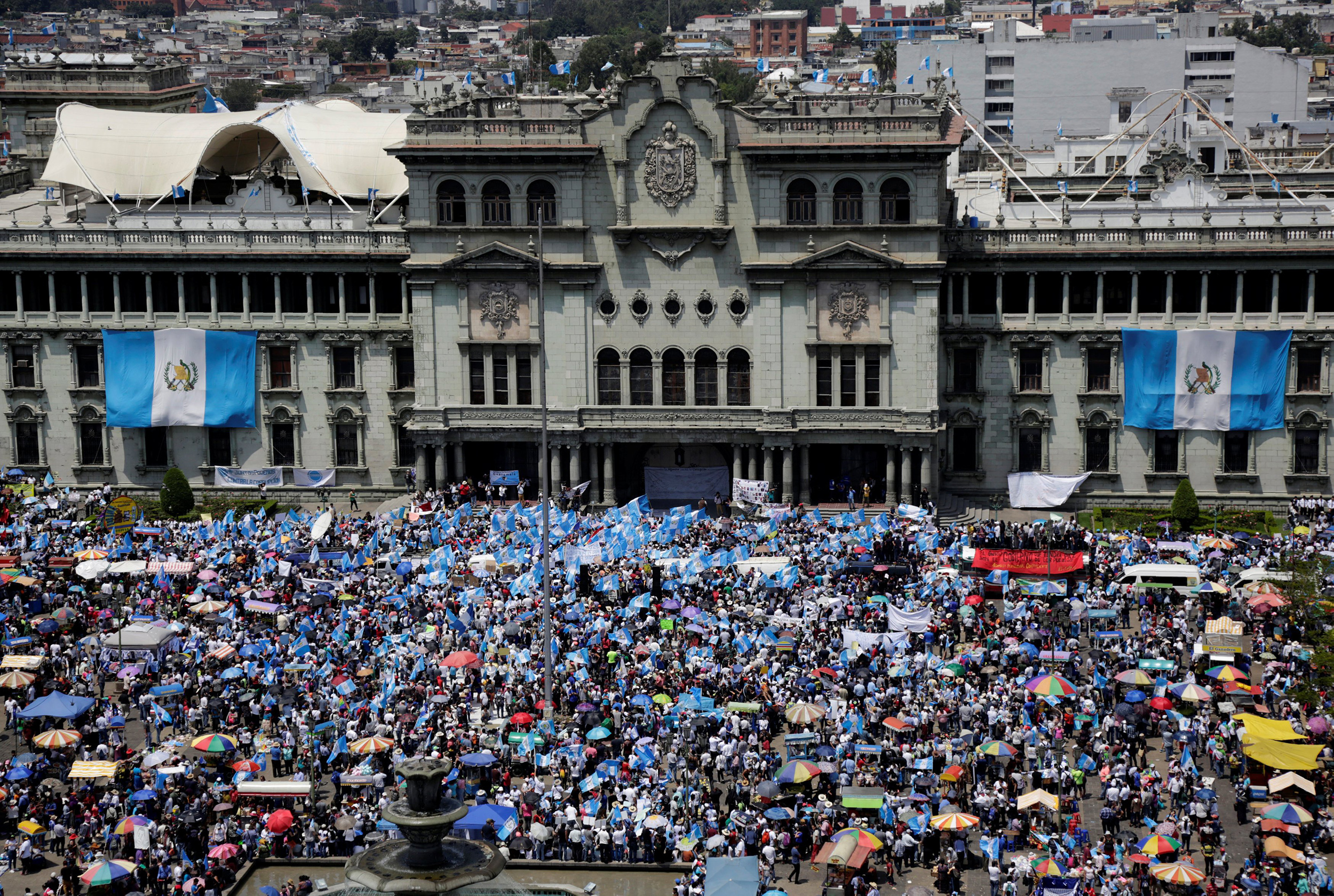 Image: Anti-government protesters participate in a march in Guatemala City