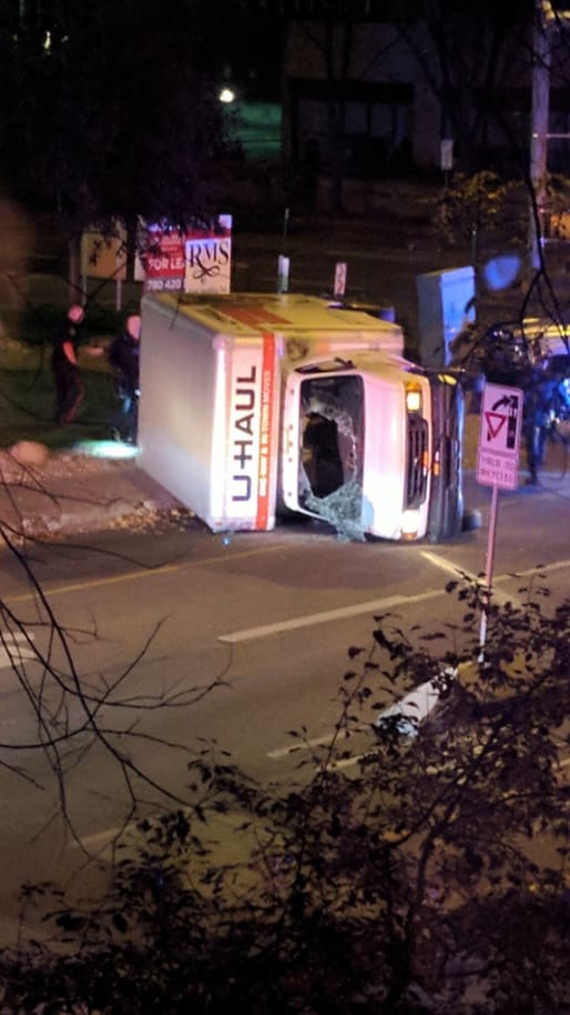 Image: The U-Haul flipped during a police chase in downtown Edmonton, Alberta, according to Canadian police.