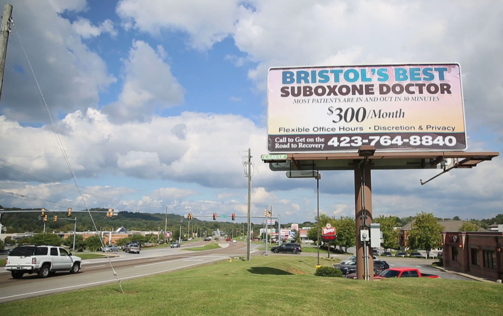 Image: A billboard advertises a clinic that distributes Suboxone