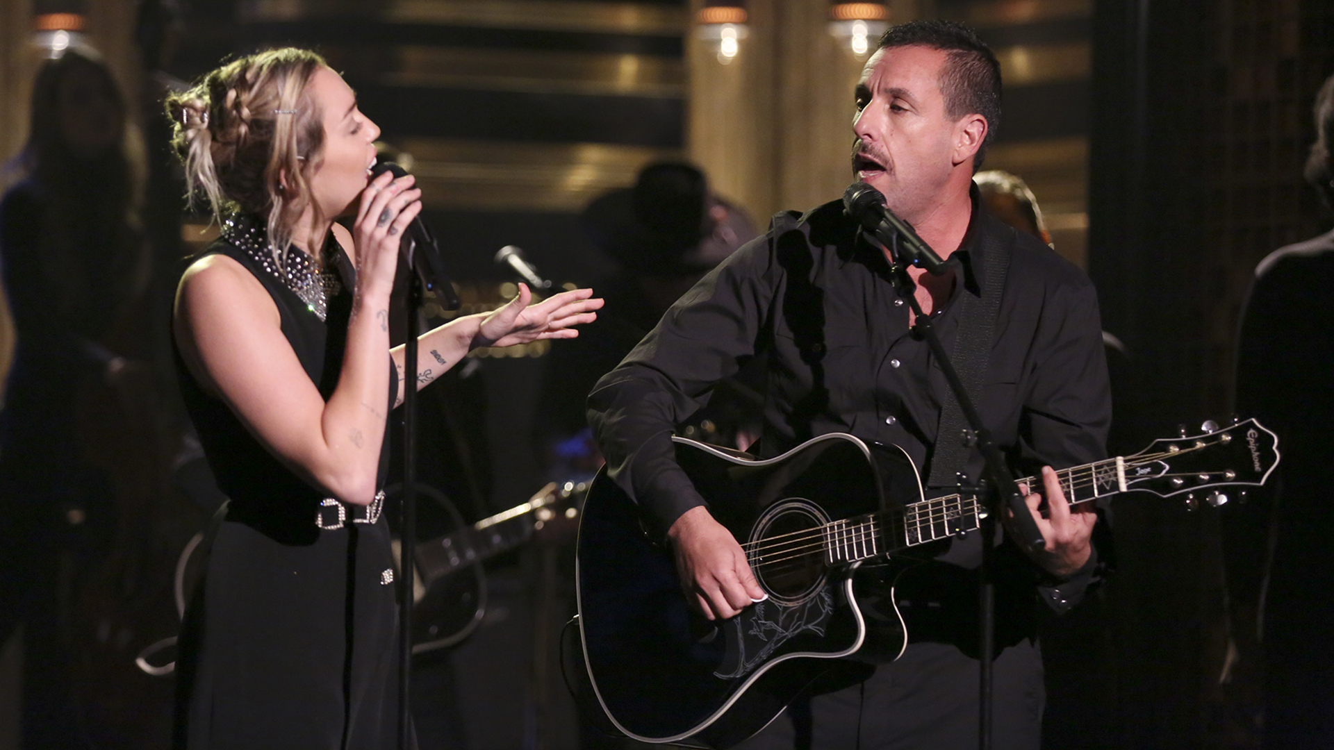 miley cyrus adam sandler perform moving las vegas tribute song on