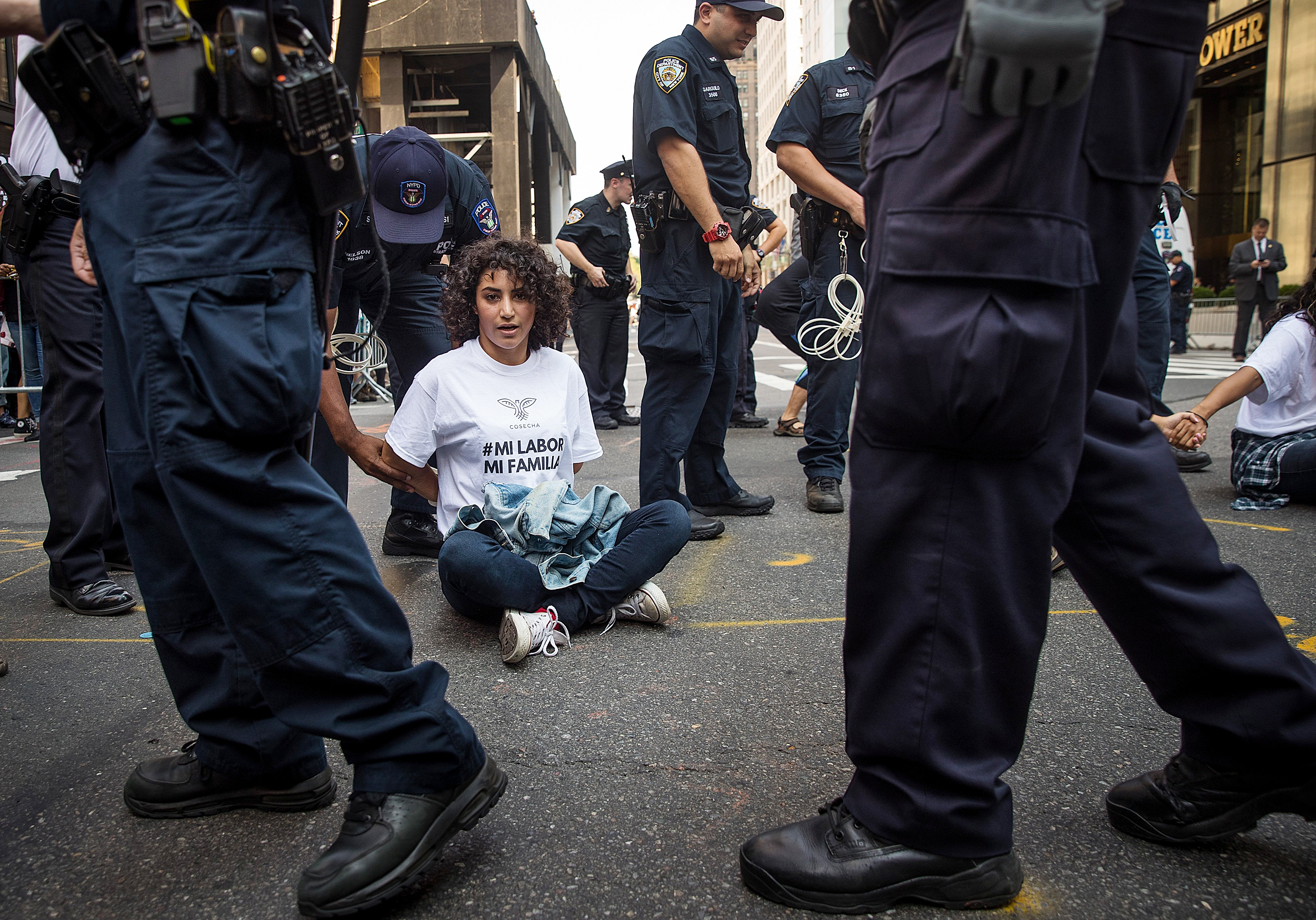 Image: Immigration activists are arrested as they protest the Trump administration's decision on DACA