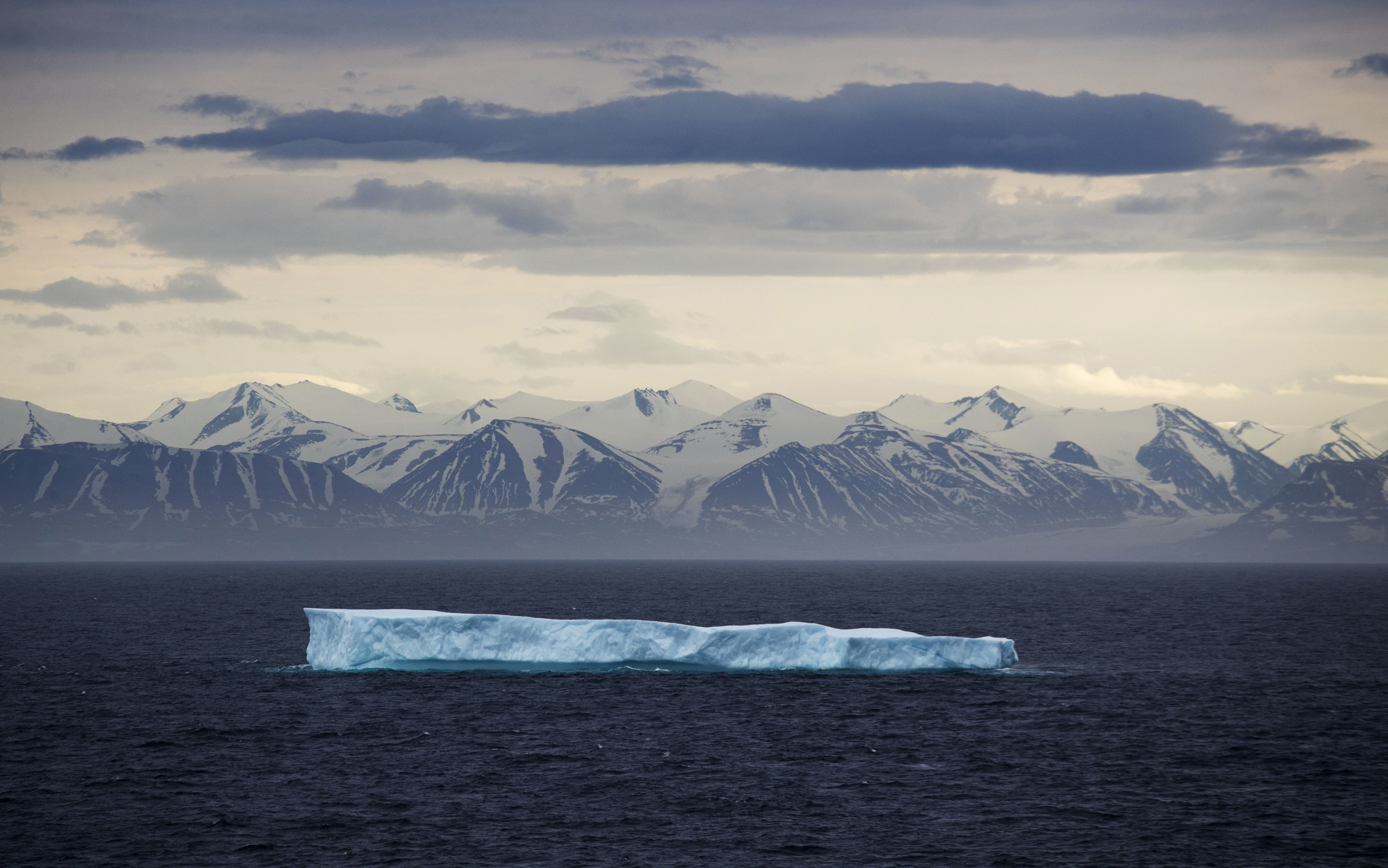 Image: An iceberg floats past Bylot Island in the Canadian Arctic Archipelago
