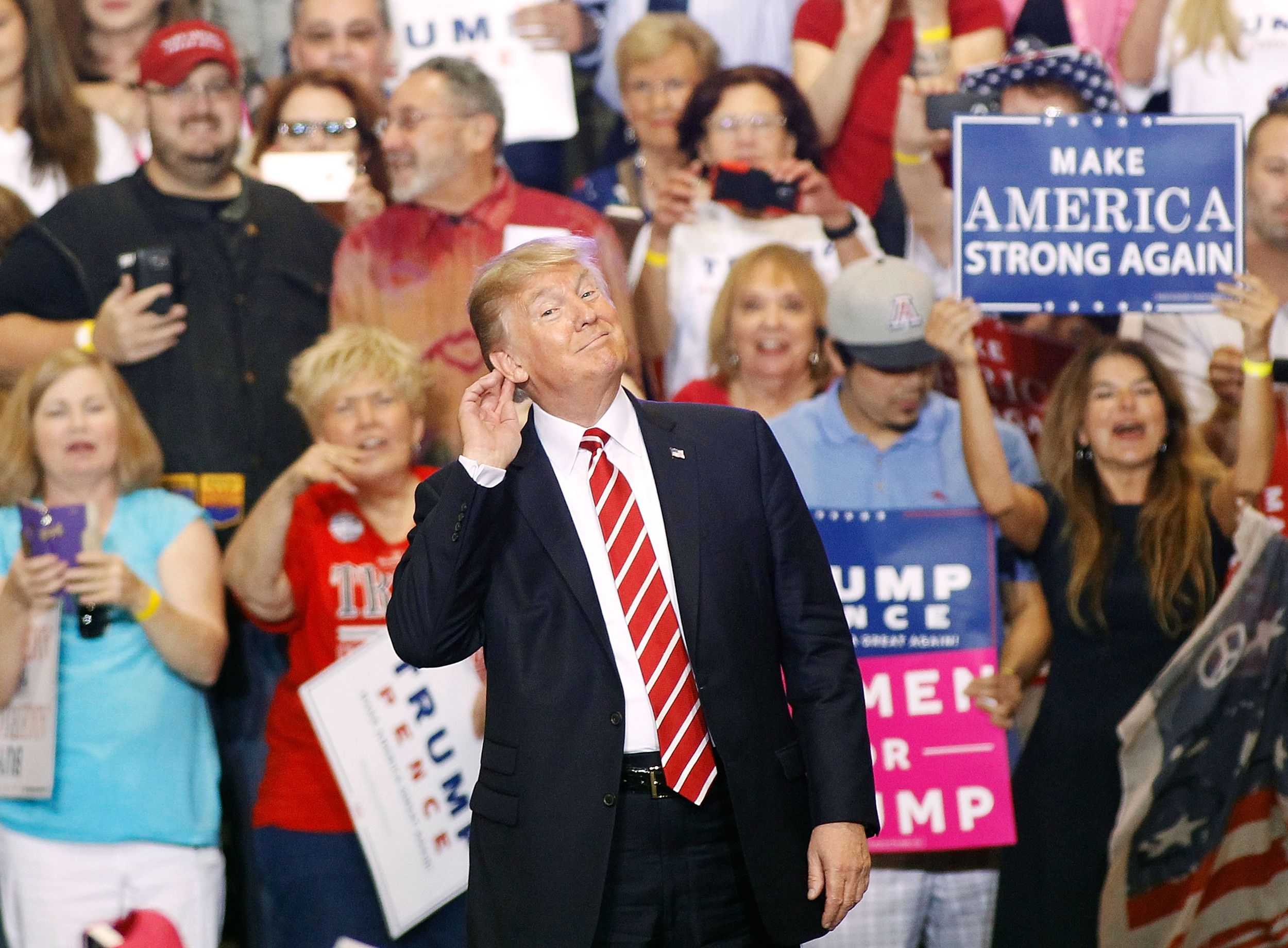 Image: Trump gestures to the crowd at a rally in Phoenix