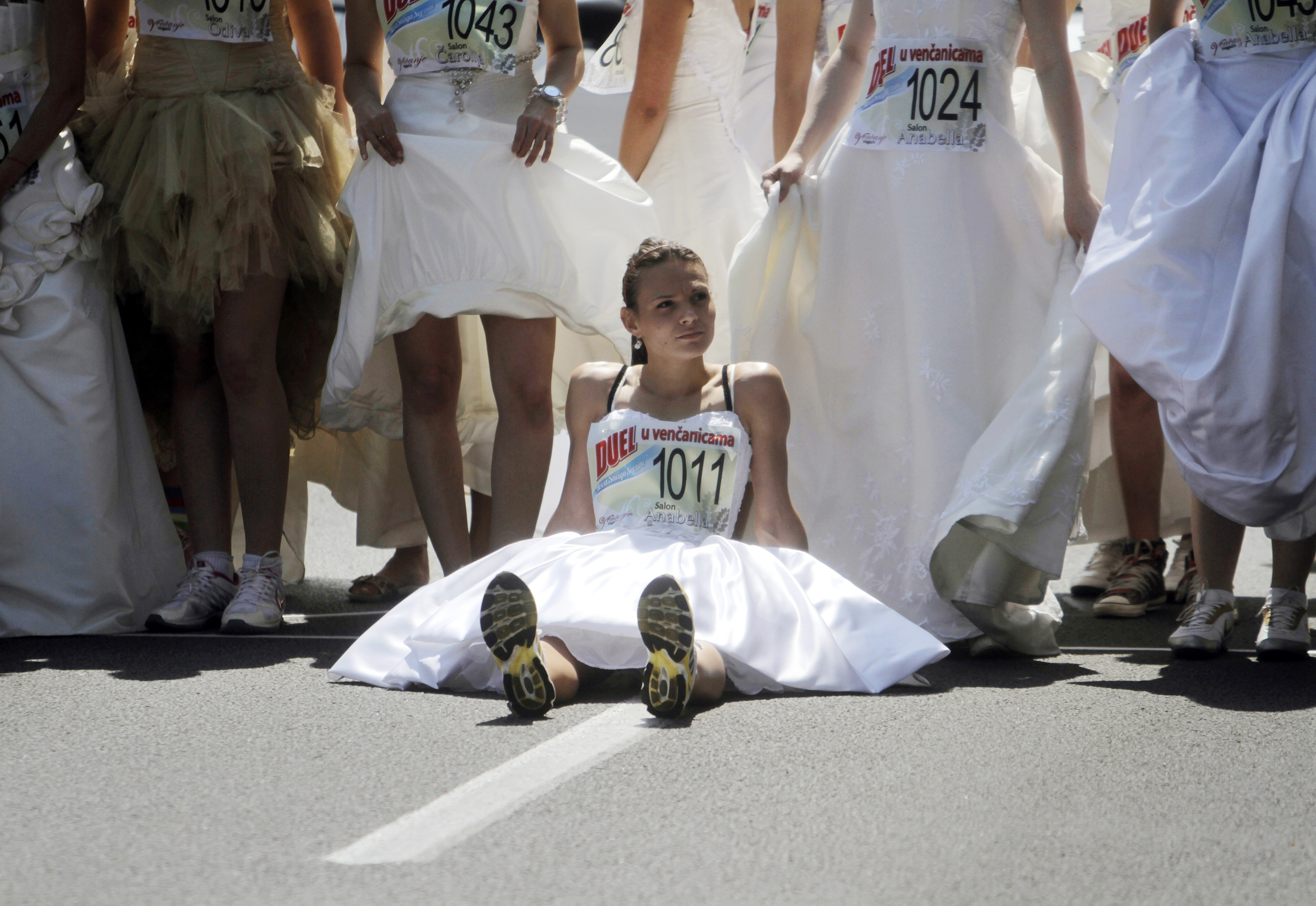 Image: A bride rests before the start of a race