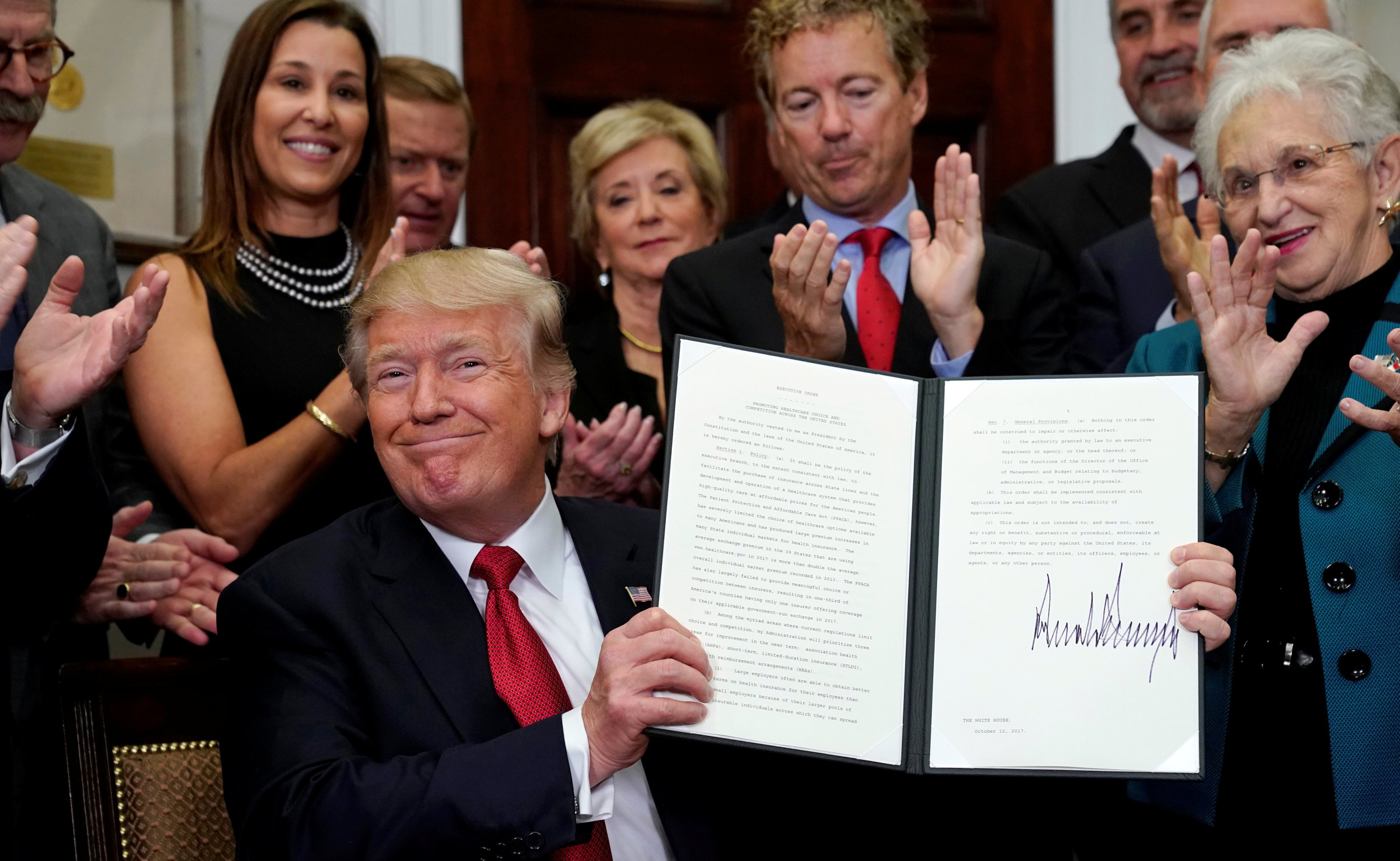Image: Trump signs an Executive Order on healthcare at the White House in Washington