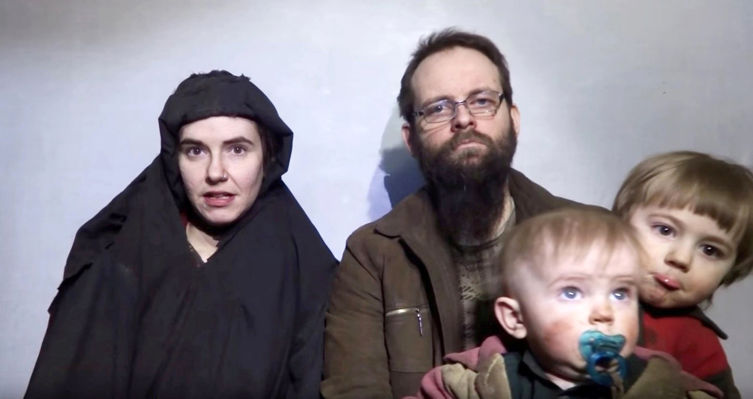 Image: A still image from a video posted by the Taliban on social media on Dec. 19, 2016 shows American Caitlan Coleman speaking next to her Canadian husband Joshua Boyle and their two sons.