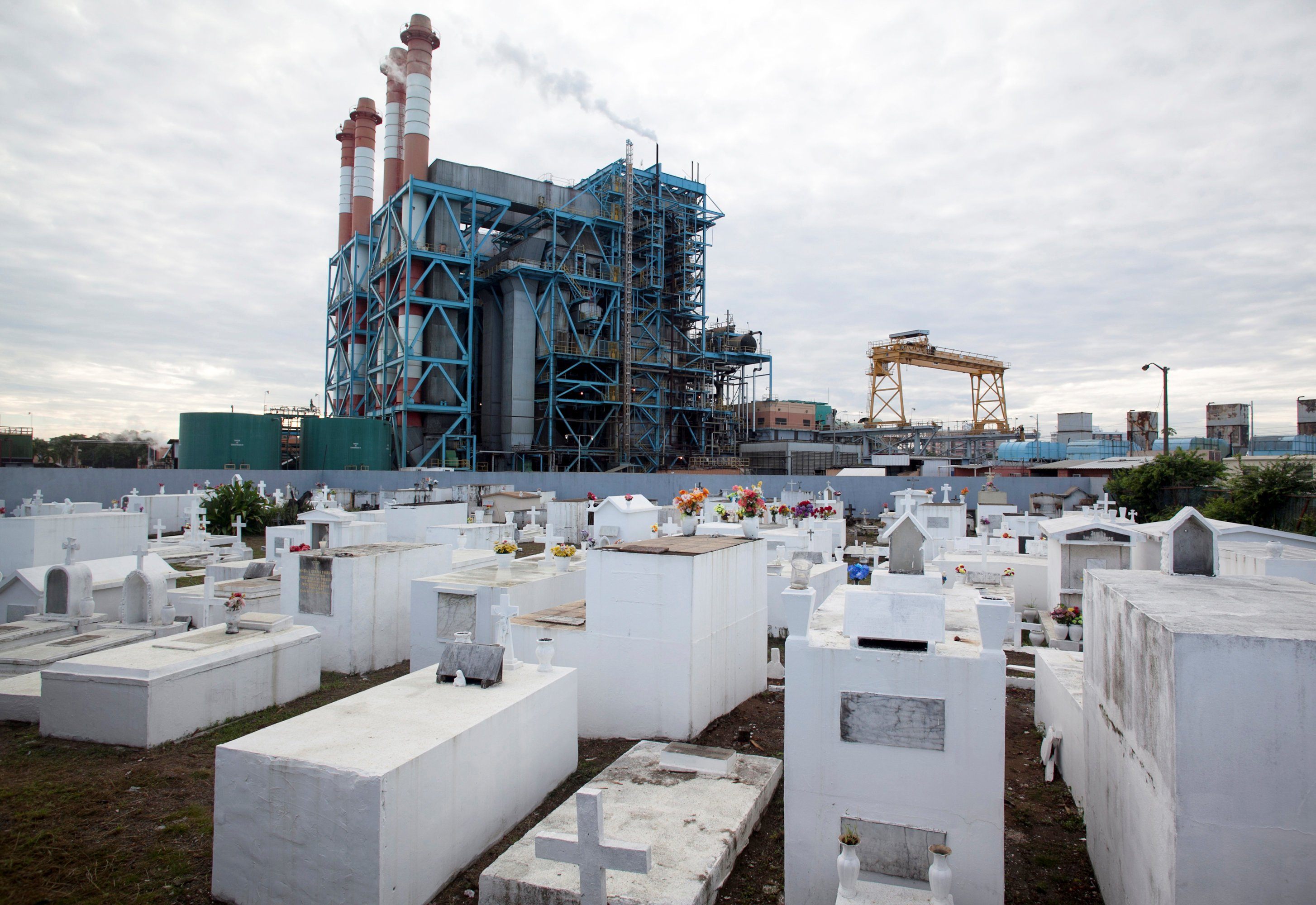 Image: FILE PHOTO: The power station Central Palo Seco of PREPA is seen behind a cemetery in San Juan