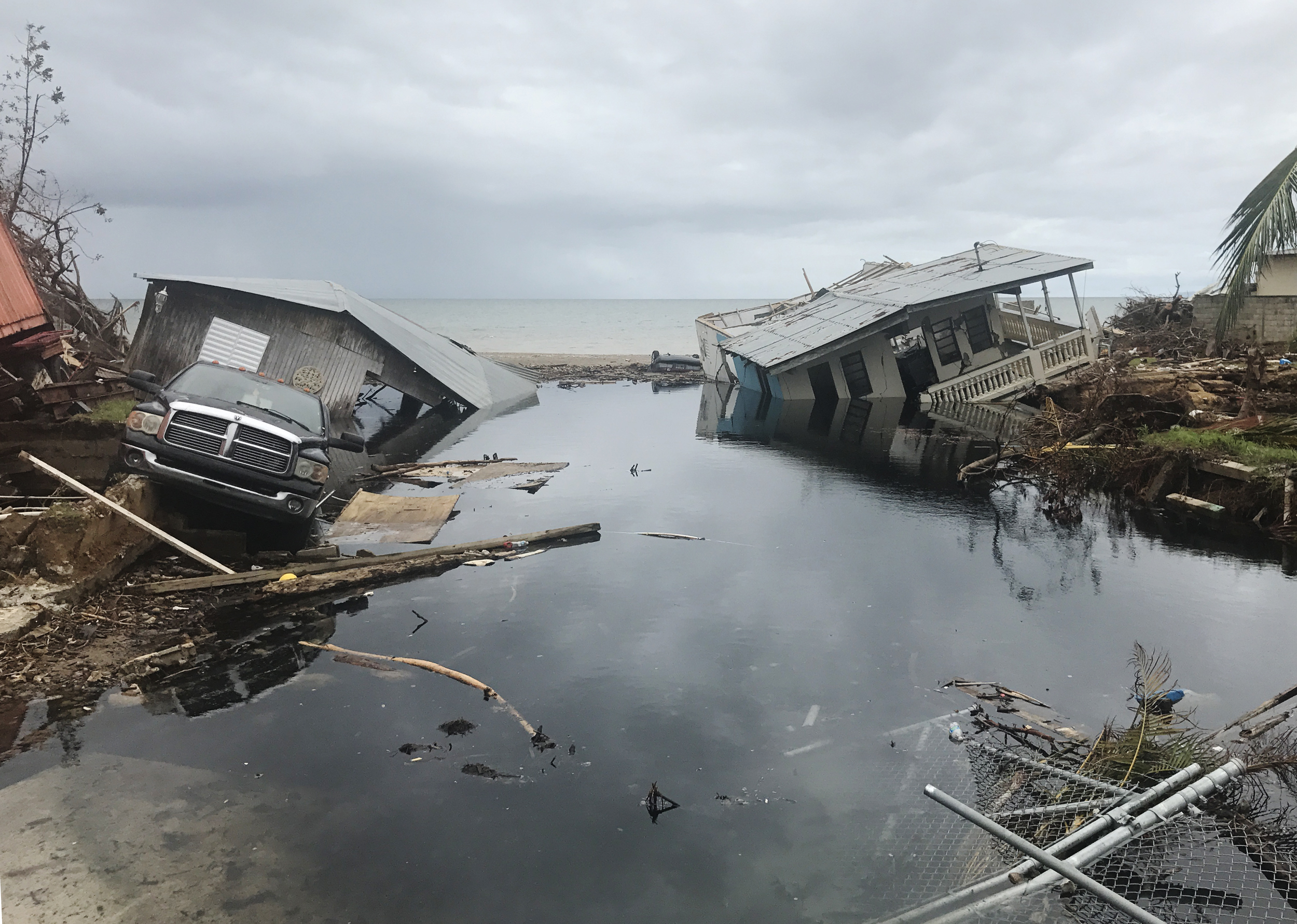 Image: Several homes collapsed in the coastal neighborhood of El Mani in Mayagüez.
