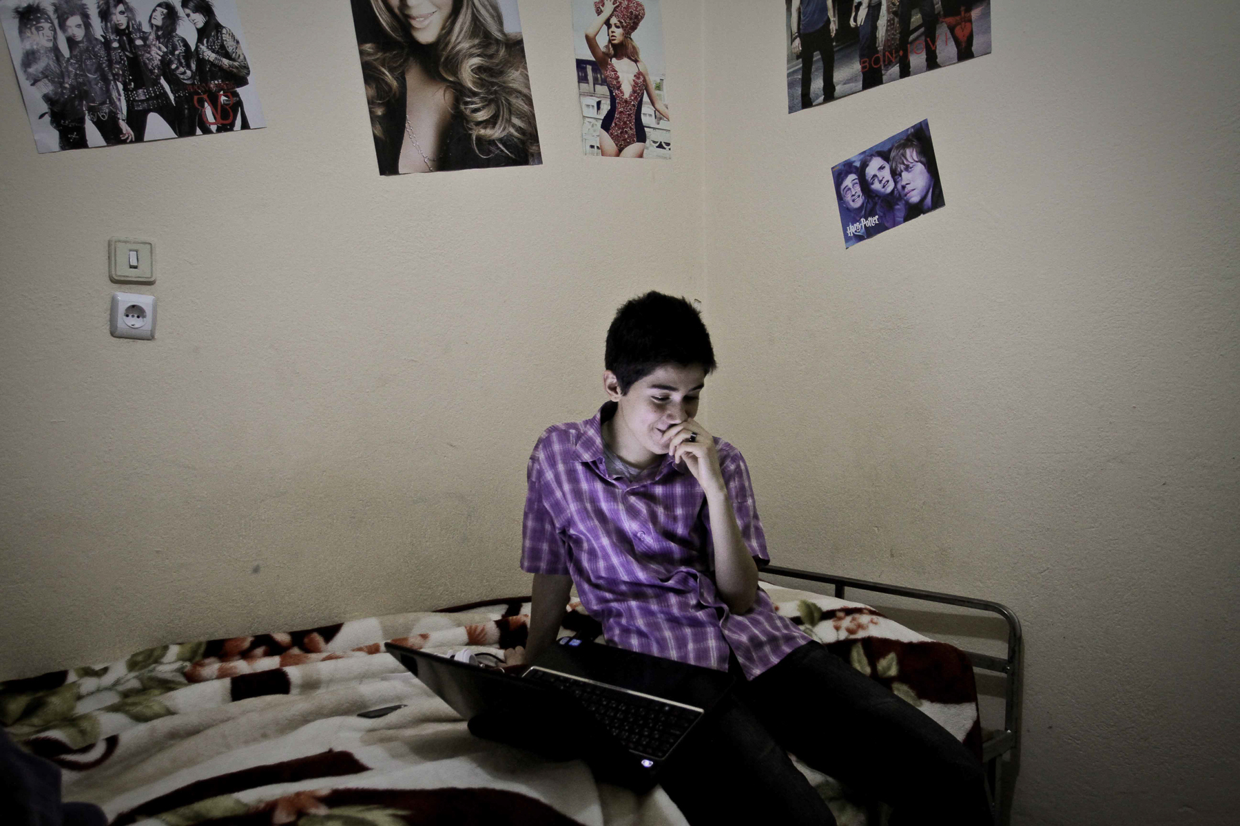 Image: Arkan, 20, chats with his girldfirend on Skype in central Turkey in 2012