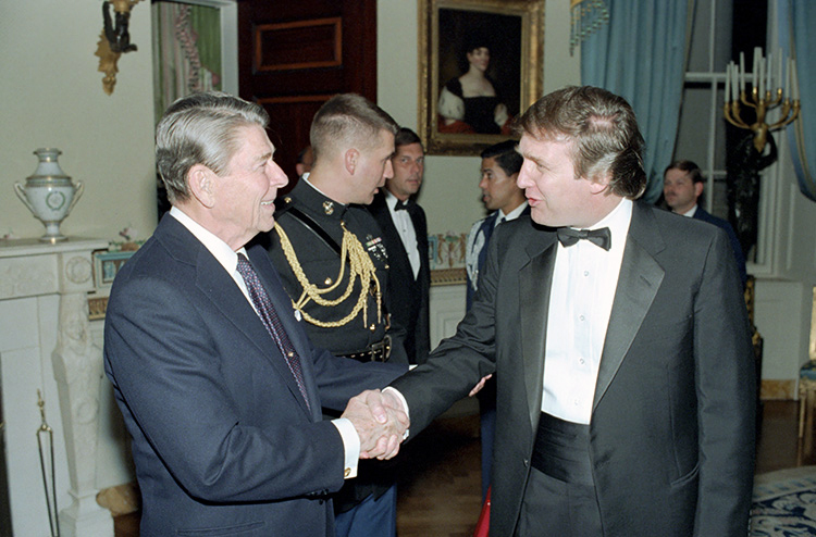 Image: Reagan shakes hands with Donald Trump in 1987