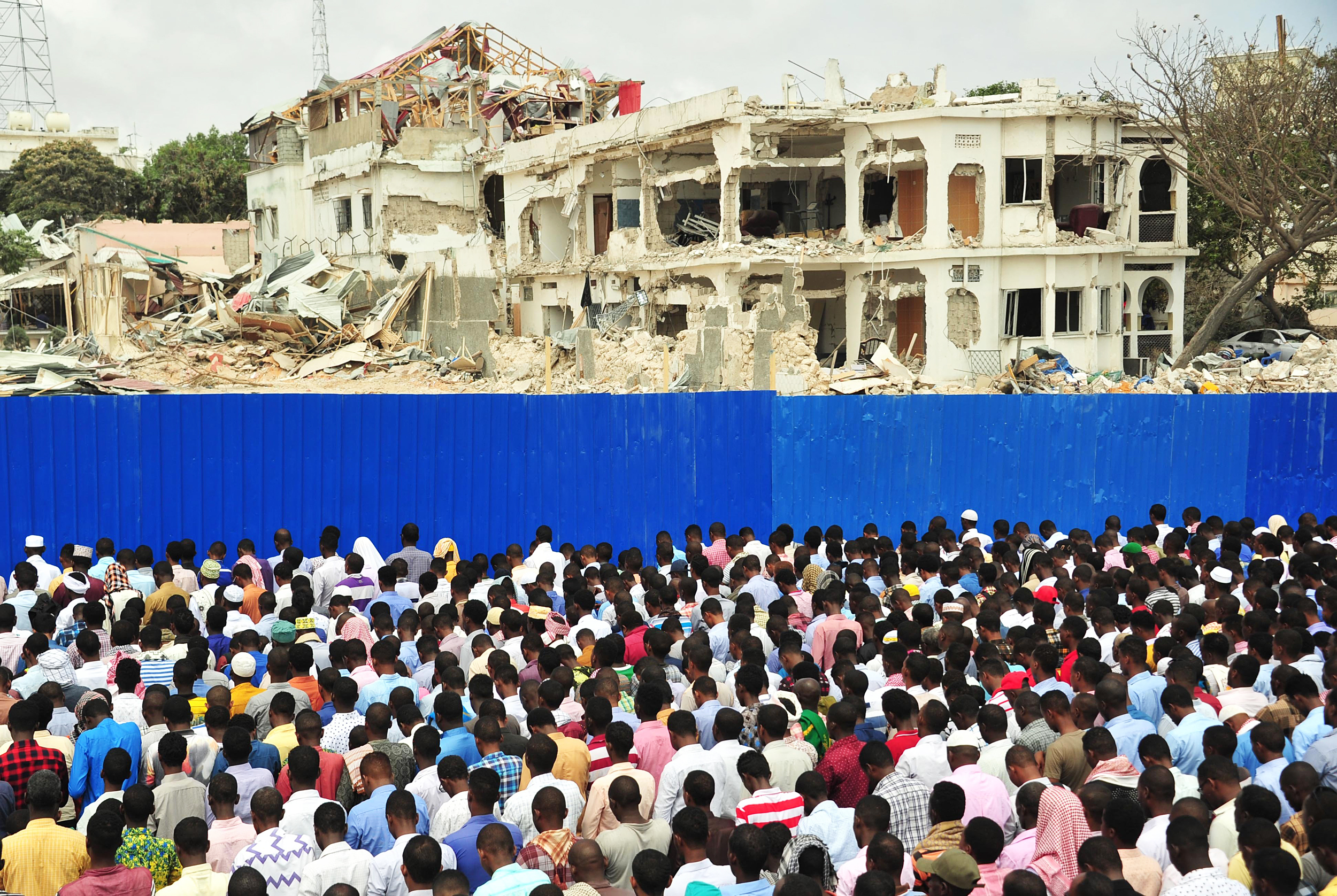 Image: Somalis pray for victims on Oct. 20, 2017 in Mogadishu on the scene of a massive truck bomb attack