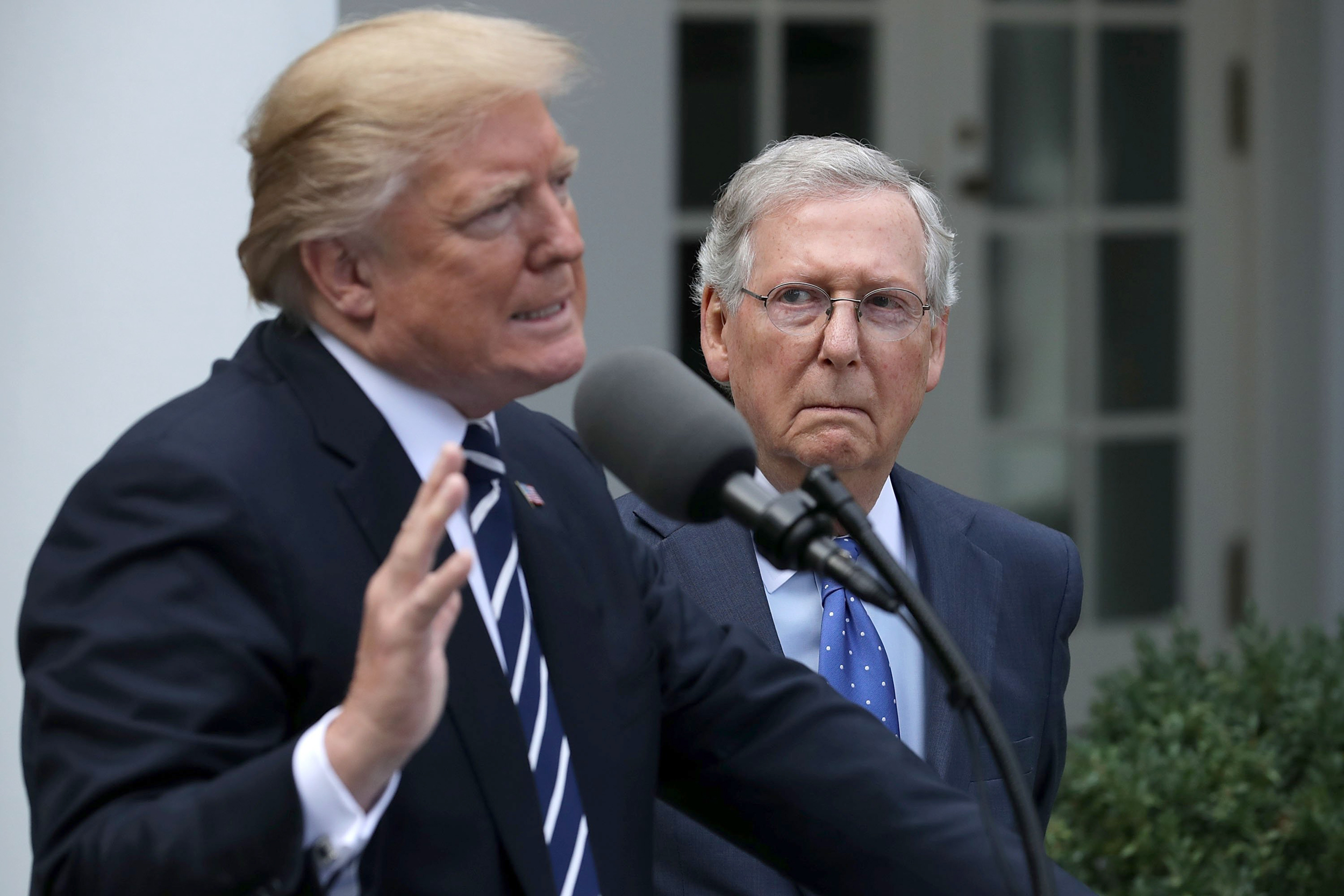 Image: U.S. President Donald Trump and Senate Majority Leader Mitch McConnell (R-KY) talk to reporters in the Rose Garden following a lunch meeting at the White House Oct. 16, 2017 in Washington, DC.
