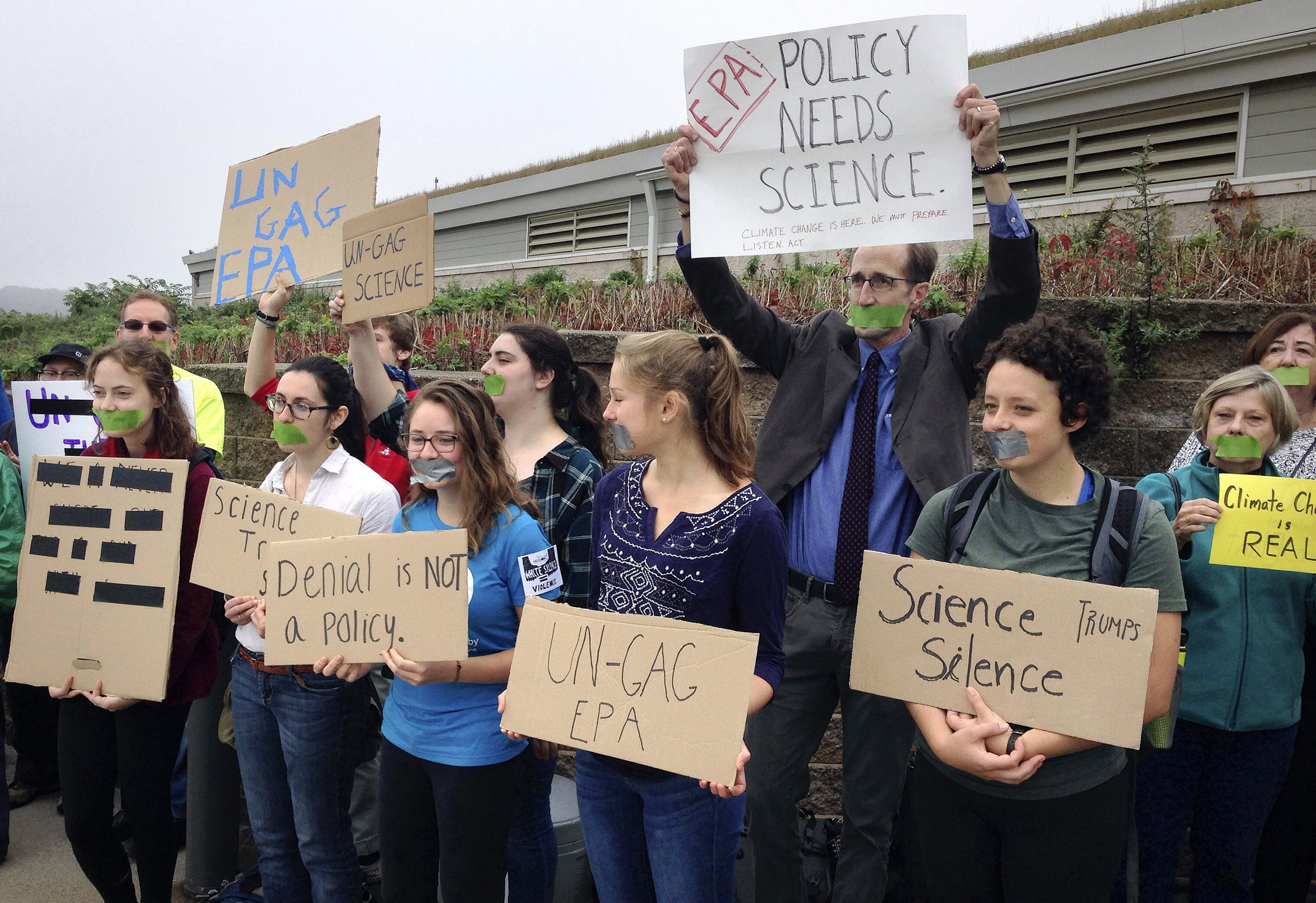 Image: Protesters gather outside a meeting where a climate change report was scheduled to be released in Providence