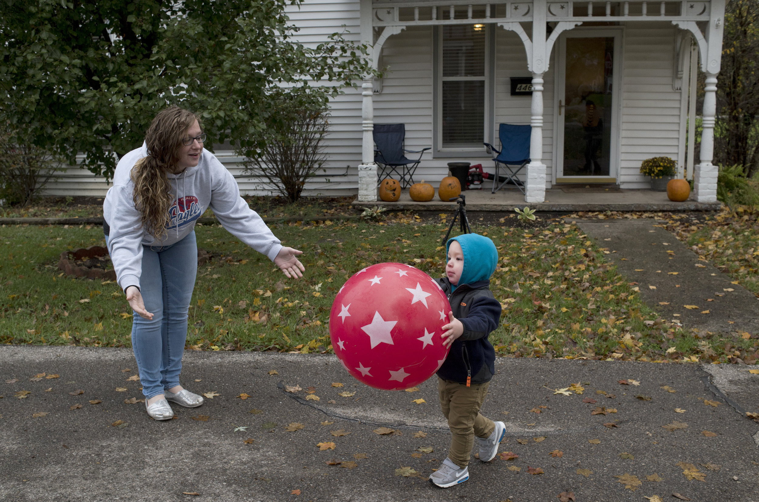 Image: Parker Hurt plays ball with his mother