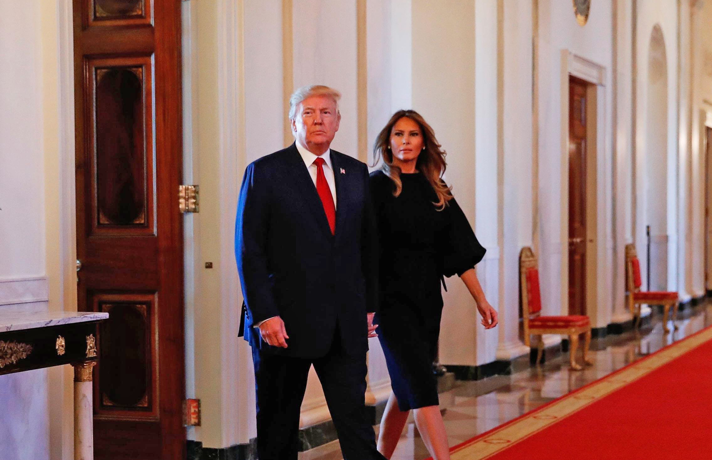 Image: U.S. President Donald Trump arrives with First Lady Melania Trump before he speaks about administration plans to combat the nation's opioid crisis in the East Room of the White House in Washington