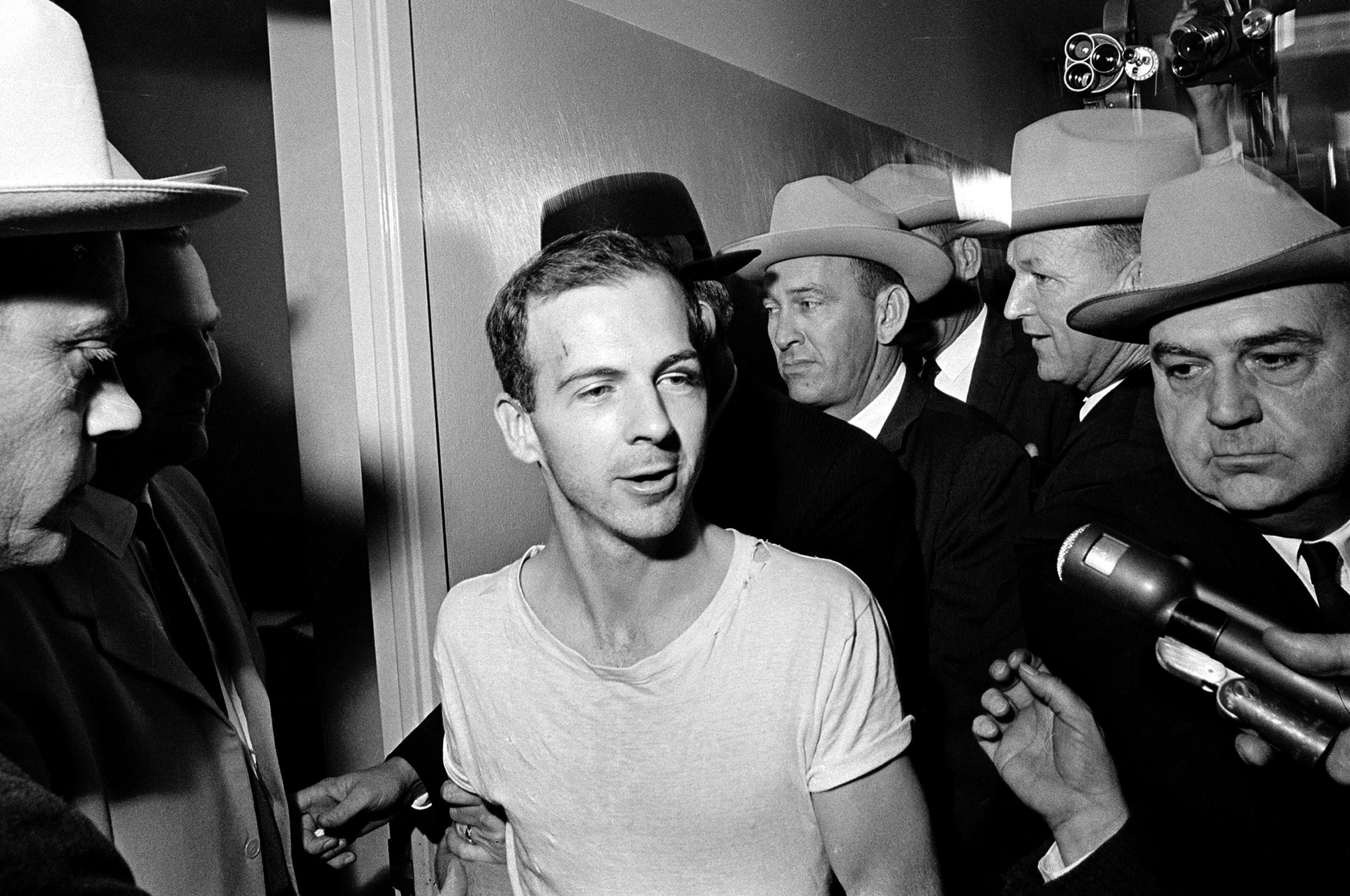 Image:  Lee Harvey Oswald talks to the media