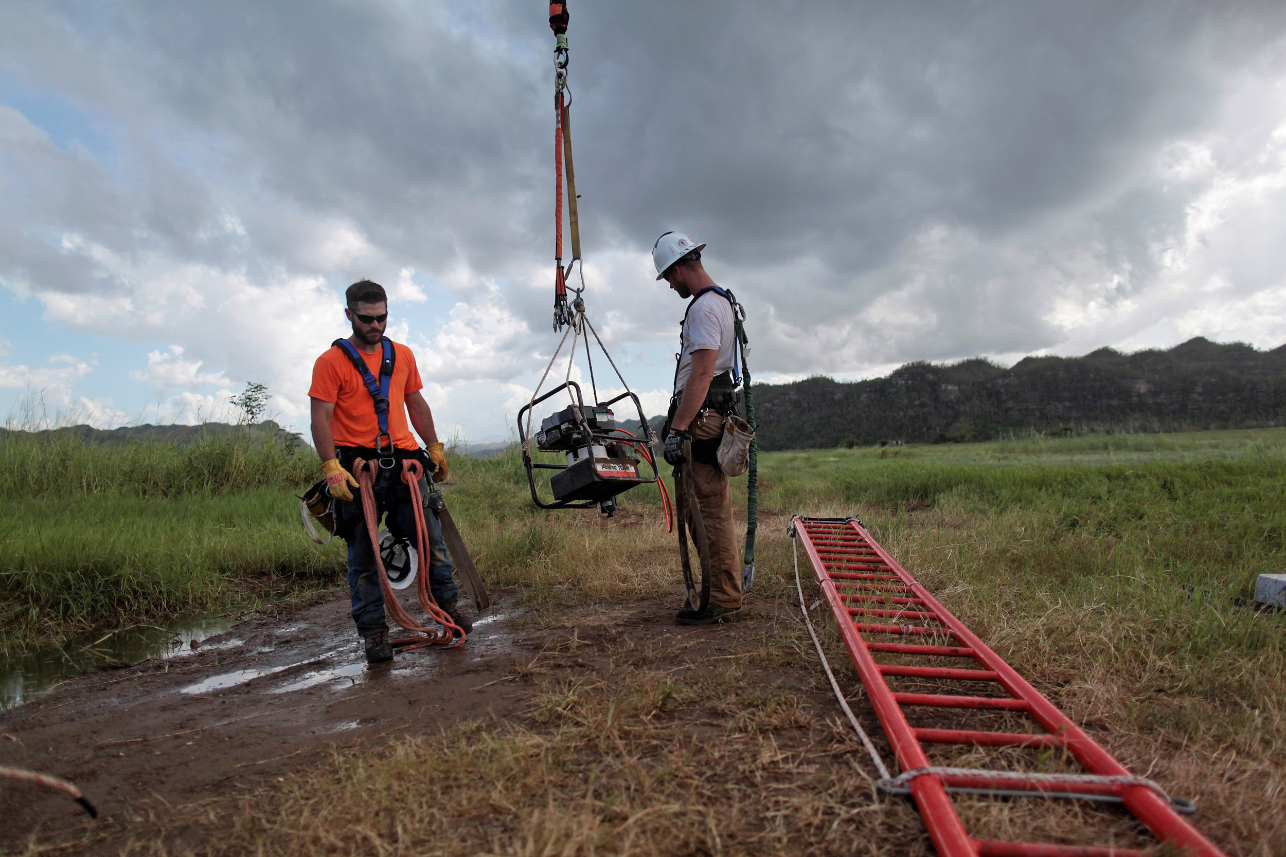 Image: Workers from Montana-based Whitefish Energy Holdings help fix the island's power grid, damaged during Hurricane Maria in September, in Manati
