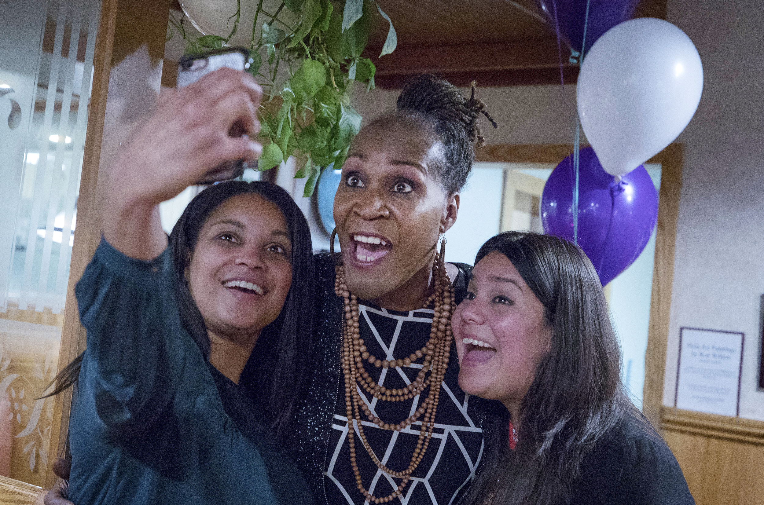 Image: Deebaa Sirdar, left, and Sara Lopez, right, take a selfie with Andrea Jenkins