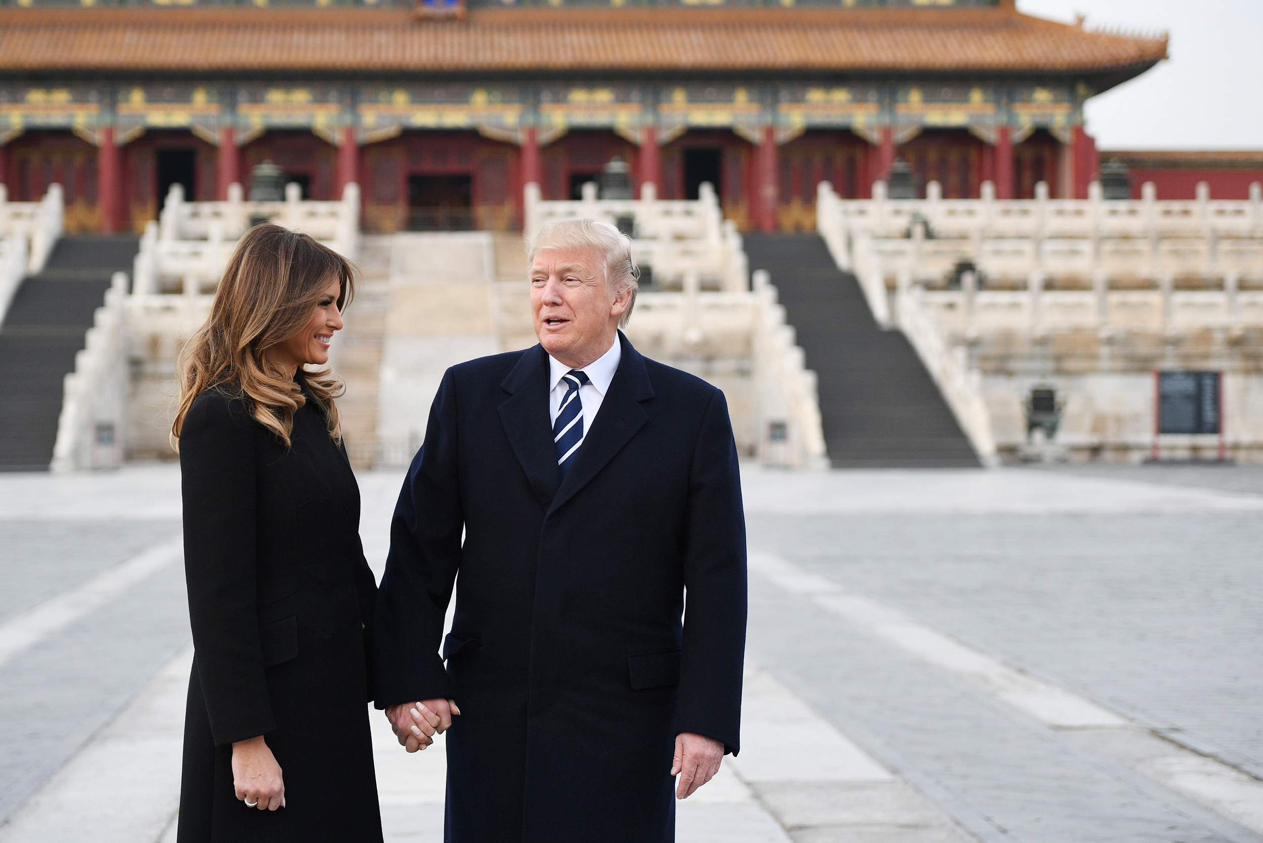 Image: US President Donald Trump holds hands with First Lady Melania Trump in the Forbidden City in Beijing