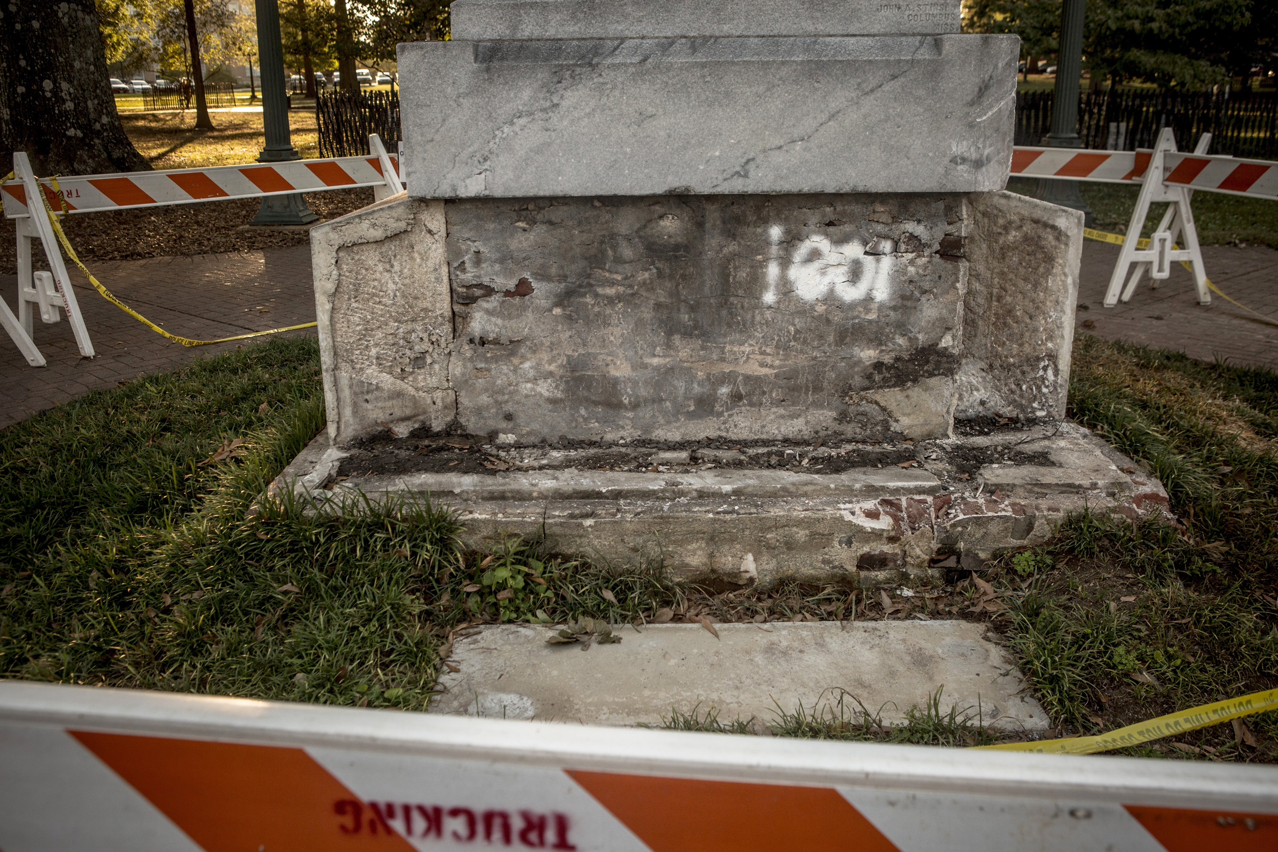 Image: Barricades surround a damaged monument to Confederate soldiers on the University of Mississippi's campus