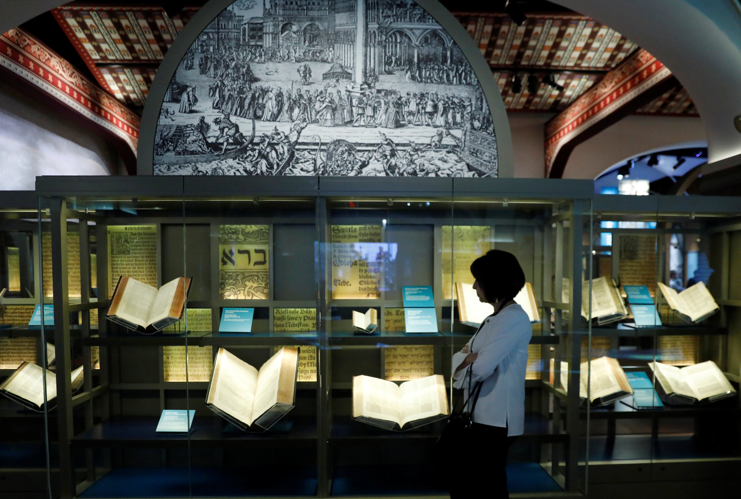 Image: A visitor looks at Bibles on display at the Museum of the Bible