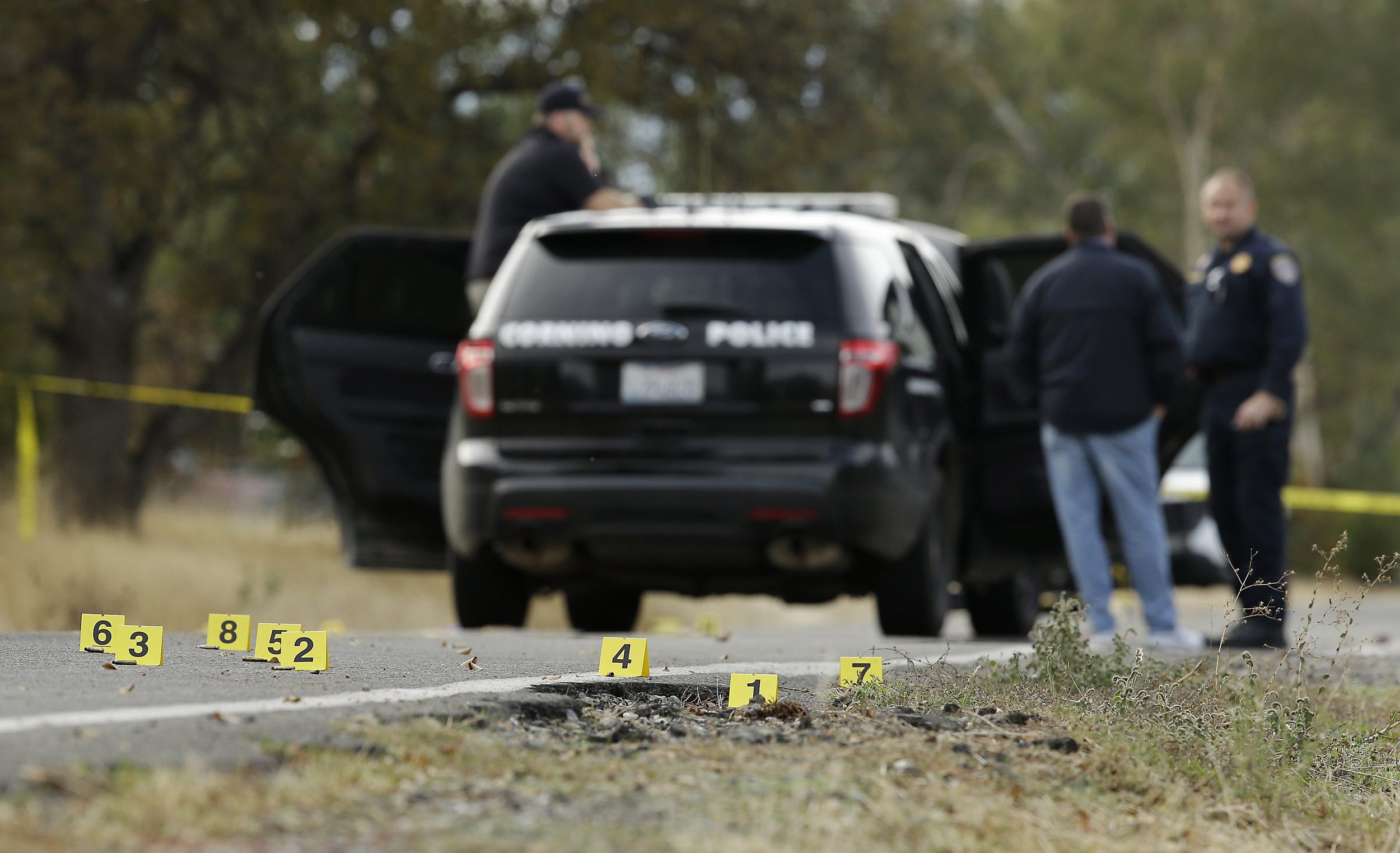 Image: Yellow tags mark where bullet casings were found