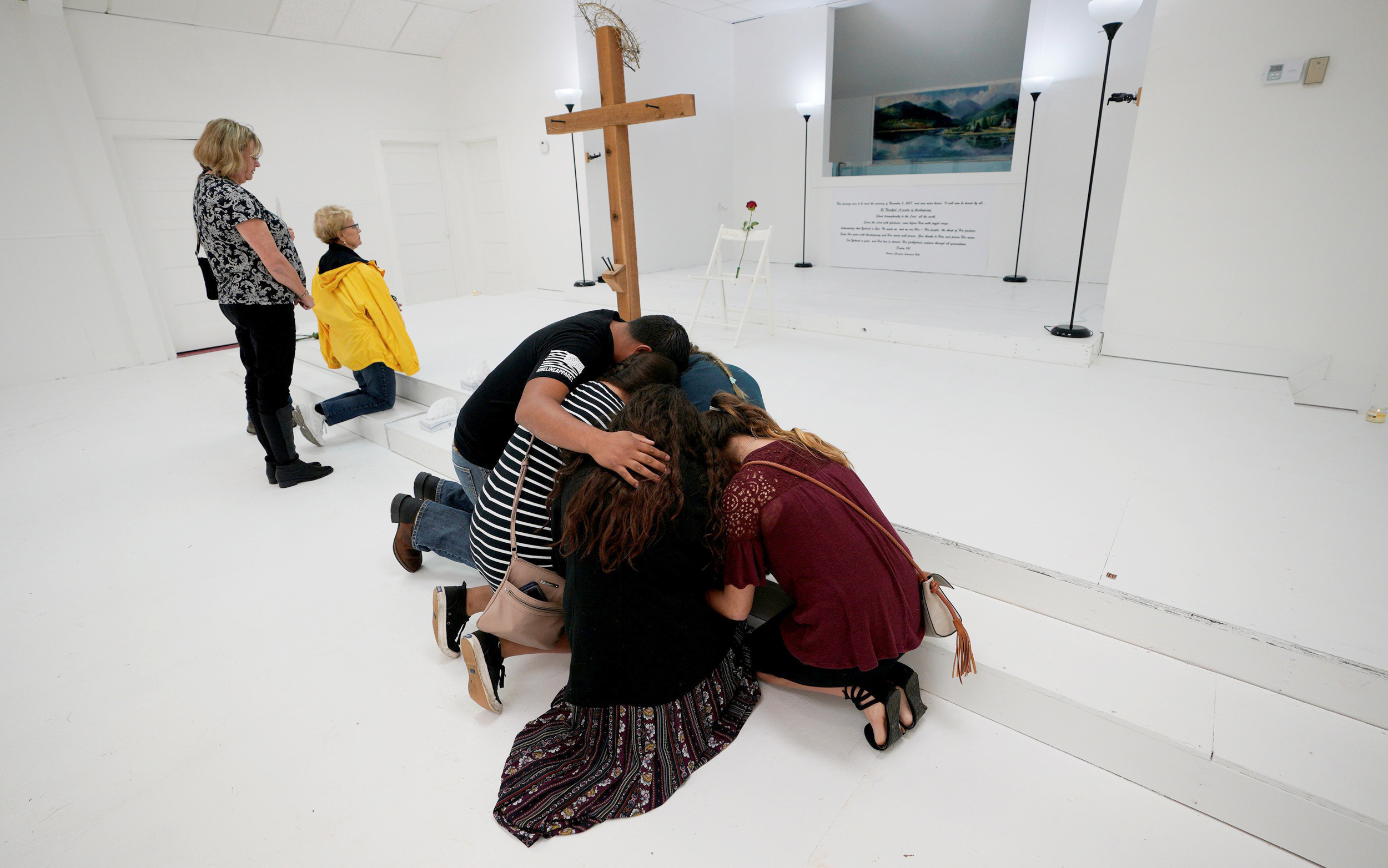 Image: People Pray in the First Baptist Church of Sutherland Springs Following the Shooting Attack in Texas