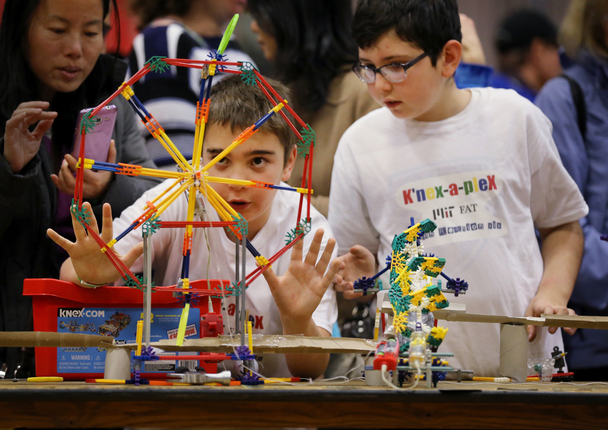 Image: Benjamin Ab, 10, left, and Micheal Kagan, 9, fine-tune their link during the 19th annual Friday After Thanksgiving (F.A.T.) Chain Reaction Event at the Rockwell Cage Gymnasium in Cambridge, Massachusetts on Nov. 25, 2016.