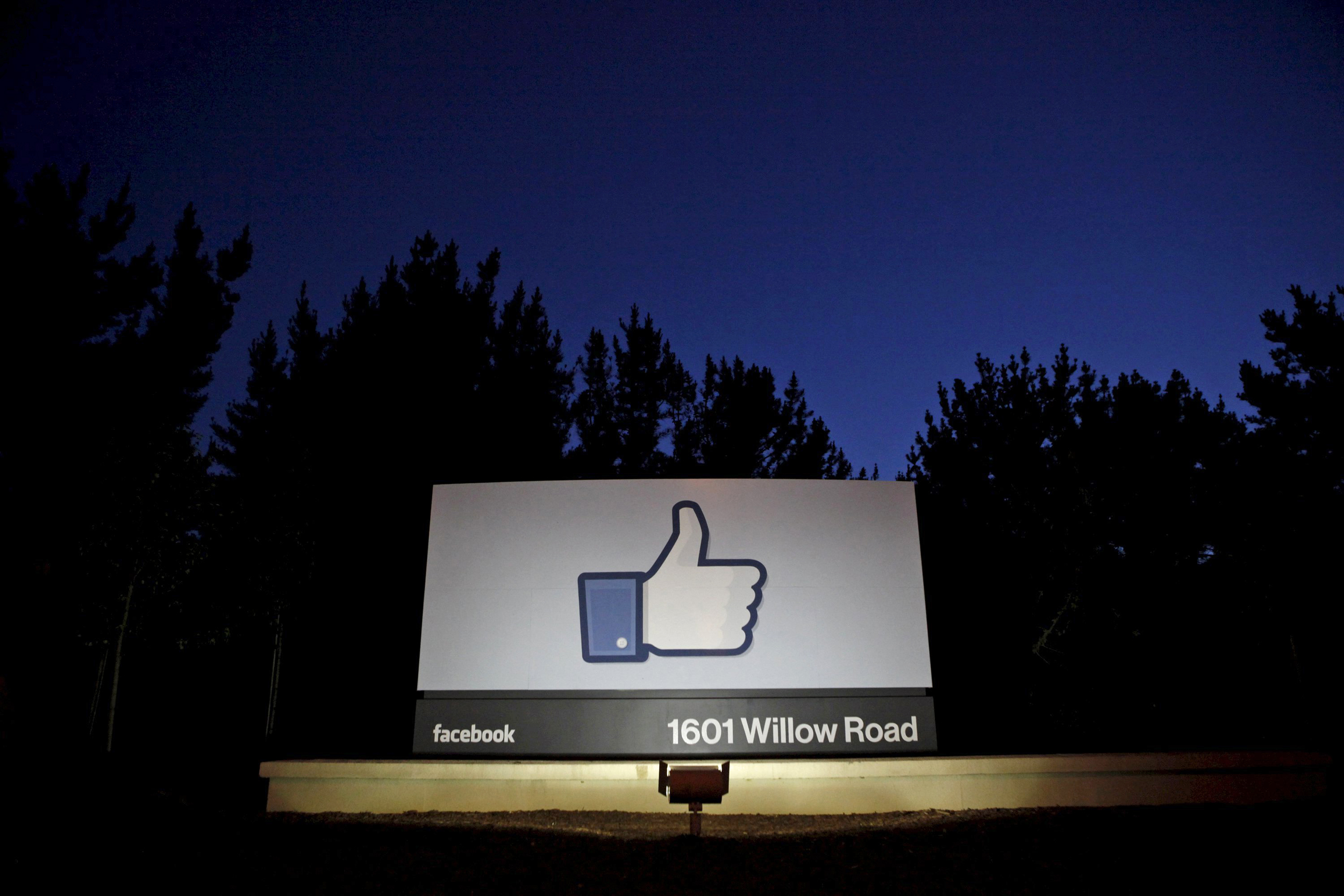 Image: The sun rises behind the entrance sign to Facebook headquarters in Menlo Park before the company's IPO launch,
