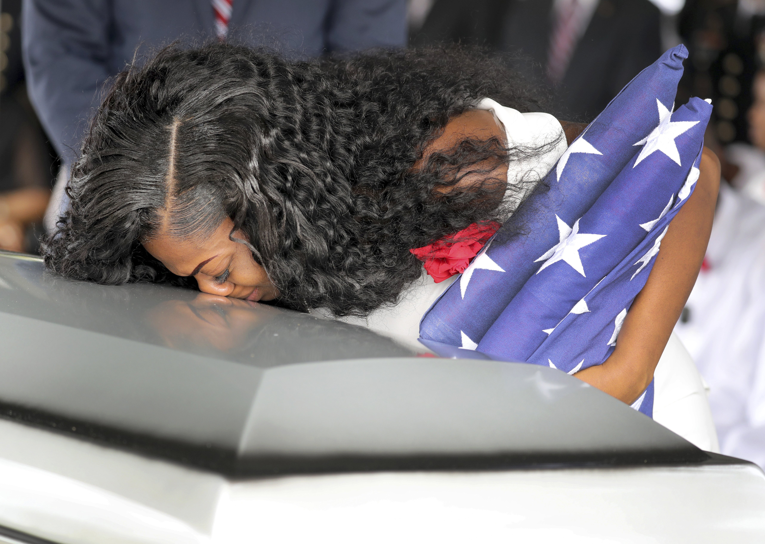Image: Myeshia Johnson, wife of U.S. Army Sergeant La David Johnson, kisses his coffin at a graveside service