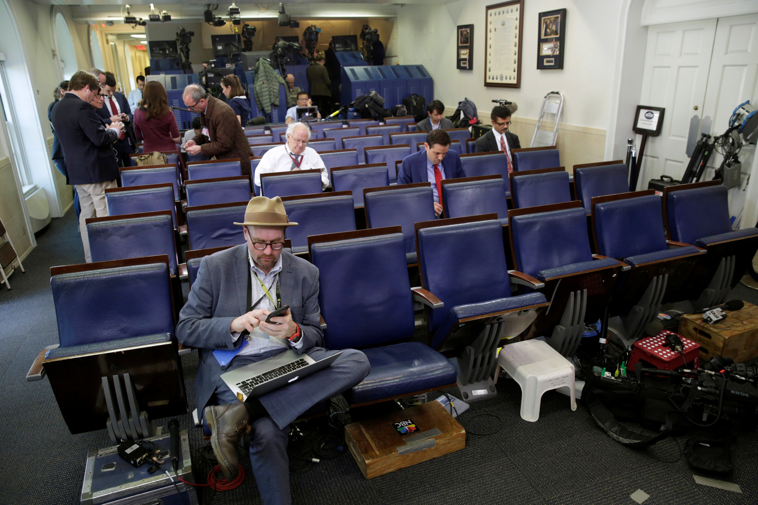 Image: Glenn Thrush, chief White House political correspondent for the The New York Times, works in the White House briefing room