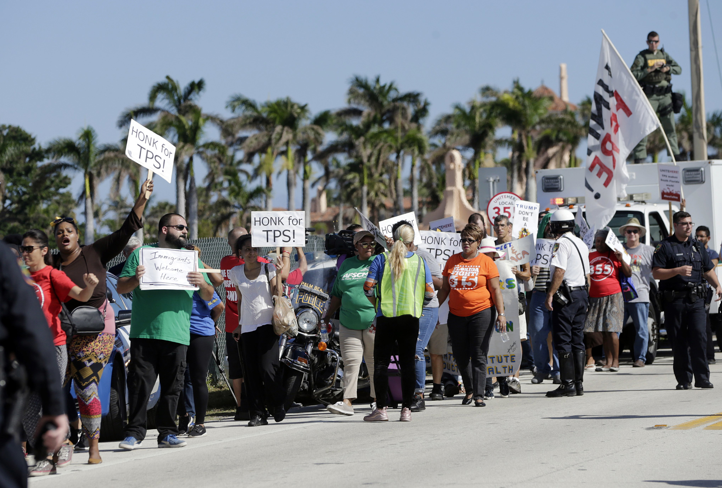 Image: Protesters march to President Donald Trump's Mar-a-Lago resort