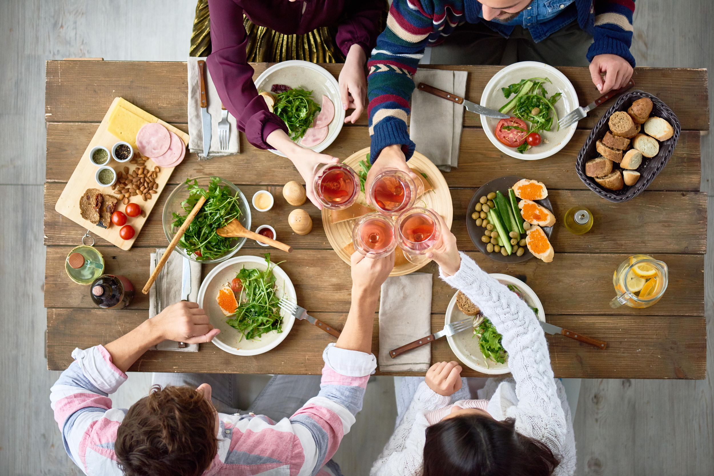 Image: Friends Gathering at Dinner Table