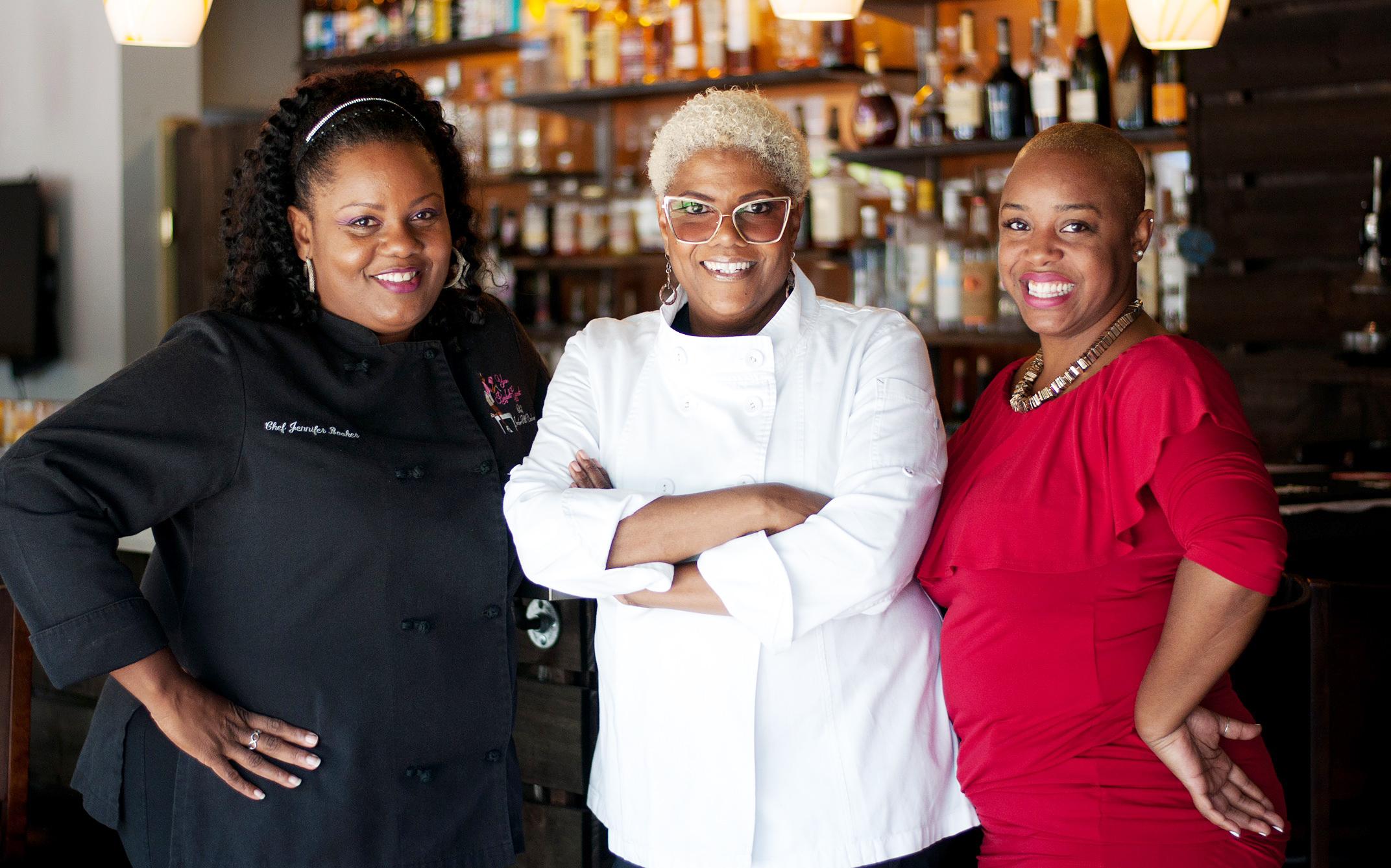 Image: Jennifer Booker, Deborah VanTrece, Tiffanie Barriere at Twisted Soul, VanTrece's restaurant in Atlanta.