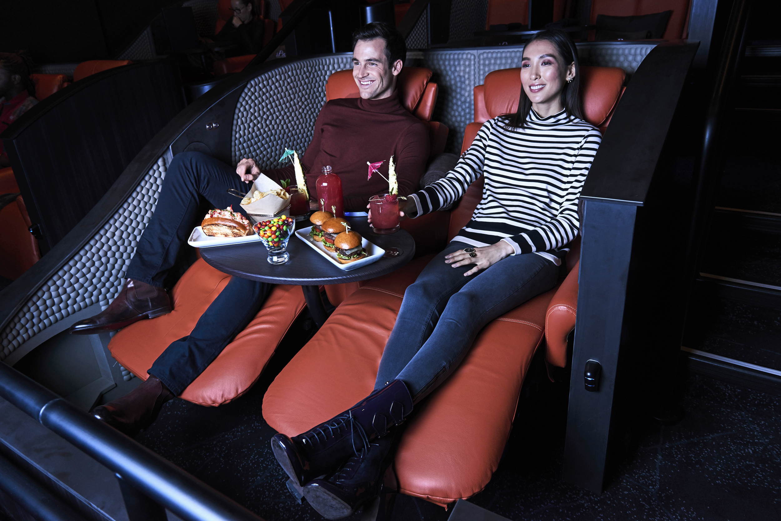 Image: iPic offers finger foods and alcohol and chaise lounge seating.