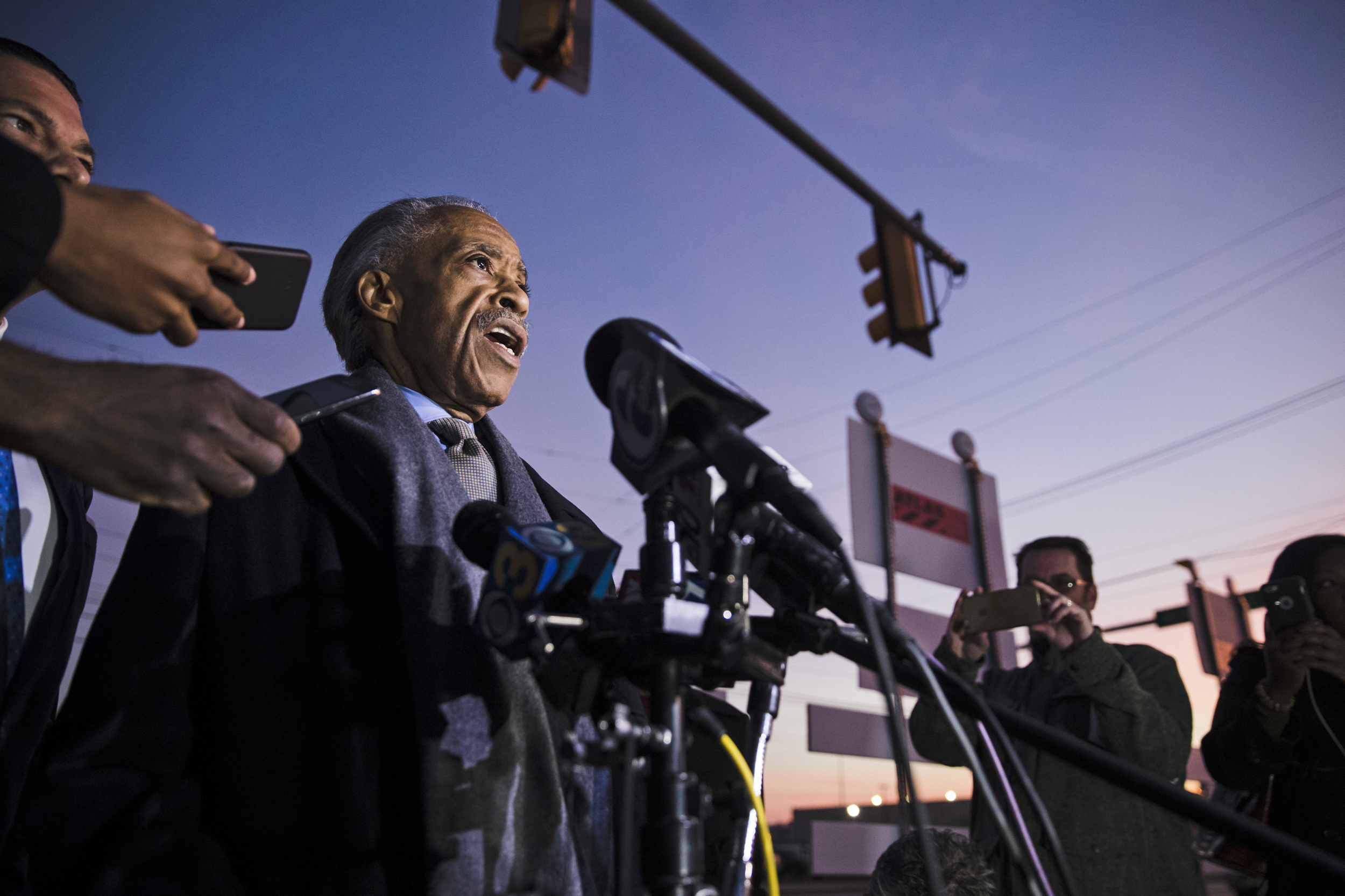 Image: The Rev. Al Sharpton speaks with members of the media