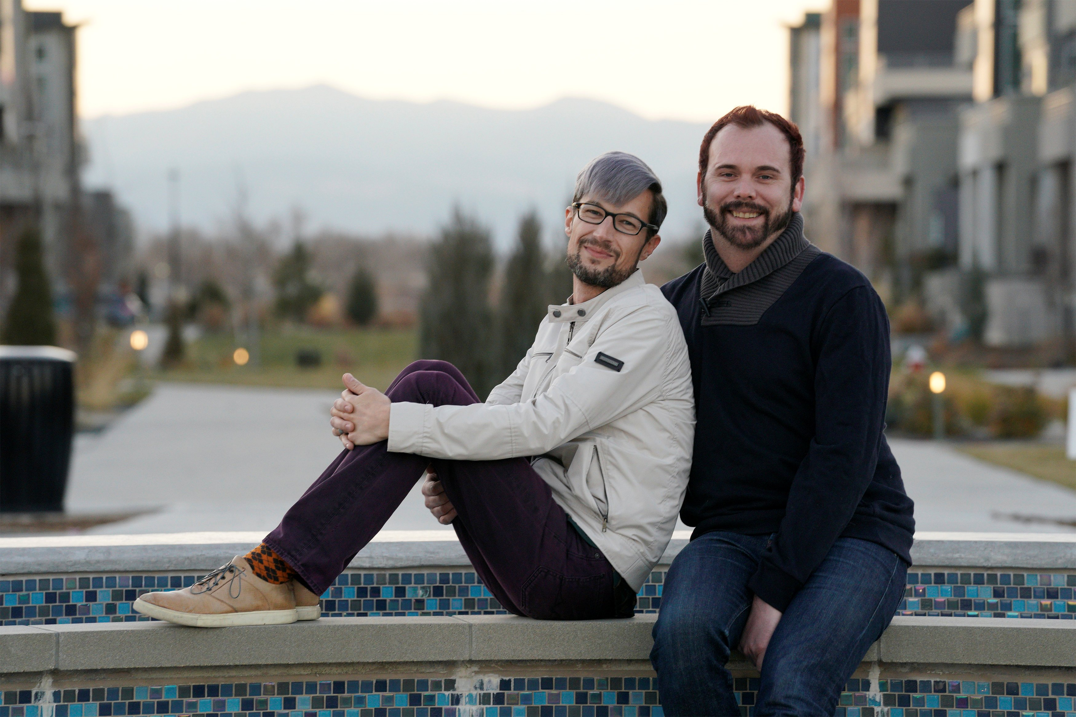 Image: Gay married couple David Mullins and Charlie Craig pose for a photo in Denver