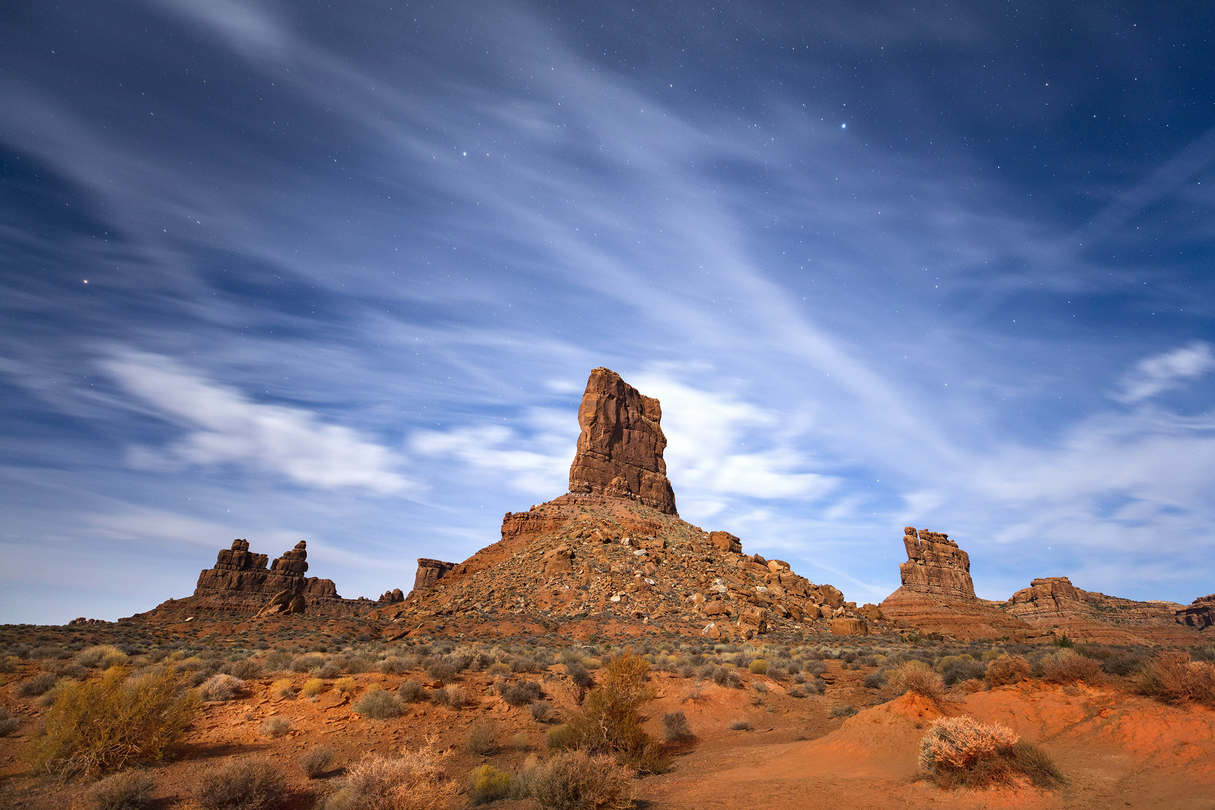 Image: Sandstone buttes rise from the Valley of the Gods under a full moon in Bears Ears National Monument