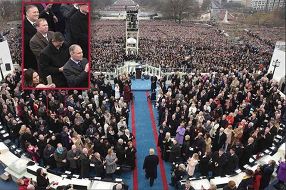 Image: Michael Flynn appears to look at his phone during President Trump's inauguration ceremony.