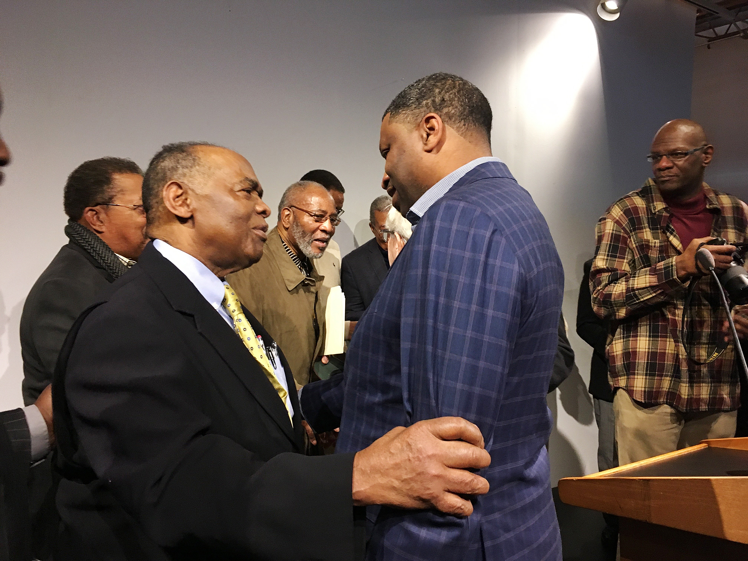Image: NAACP President Derrick Johnson, right, speaks with Dr. Robert Smith, former president of the Medical Committee for Human Rights