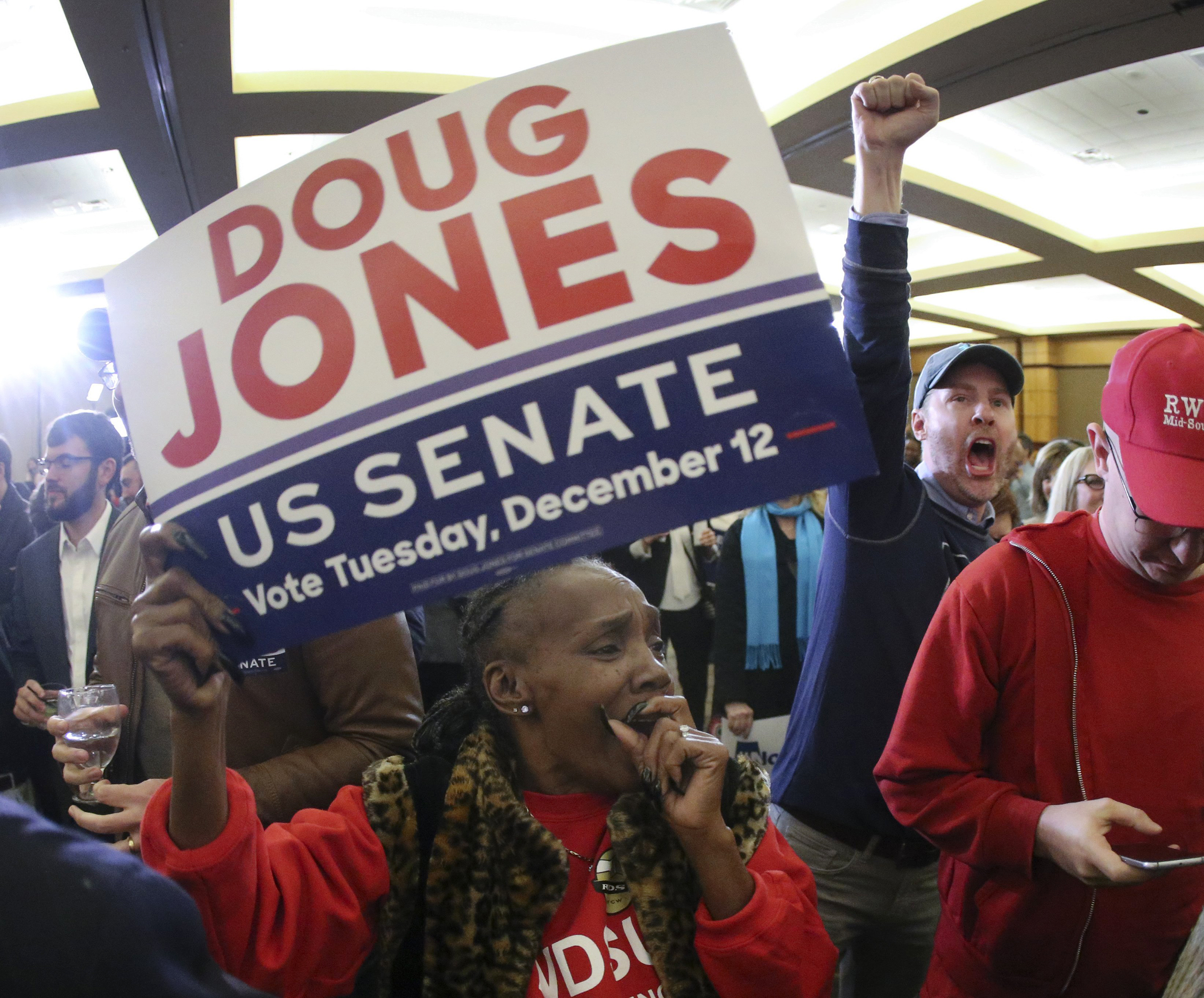Image: Doug Jones supporters cheer as they watch results at an election night watch party