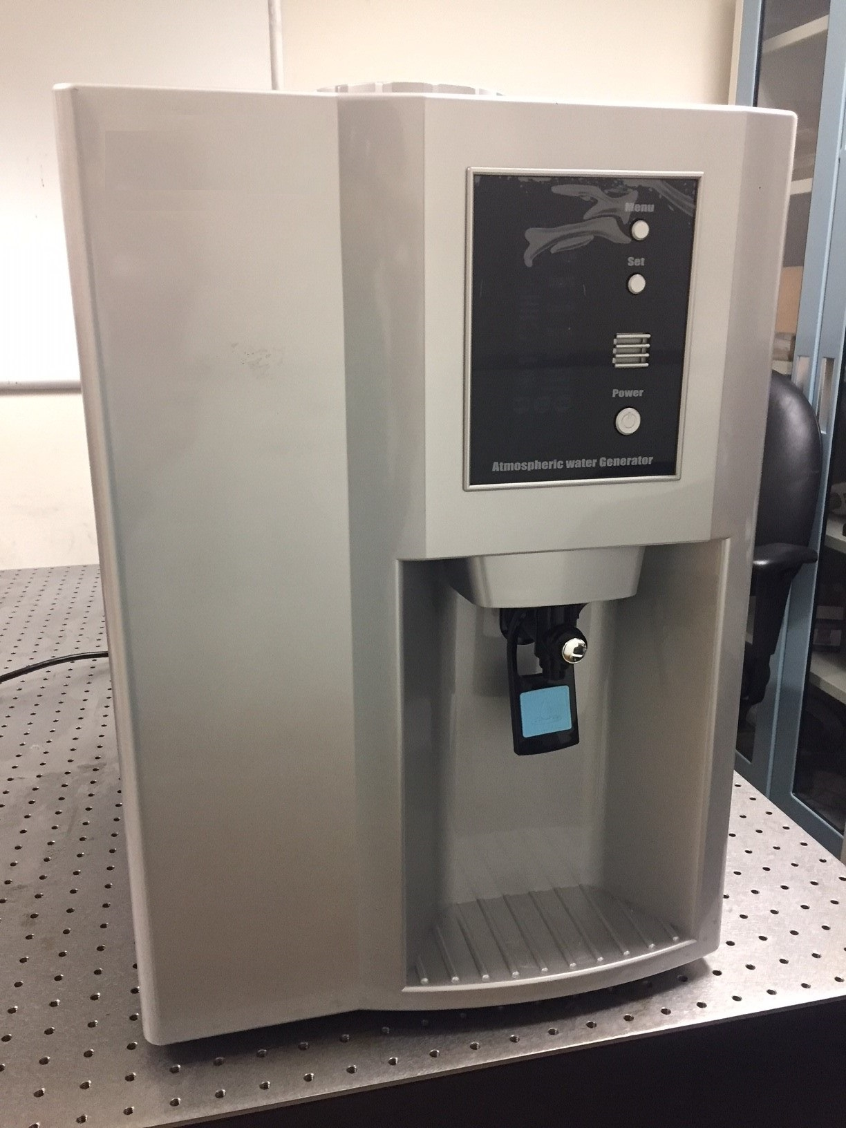 This prototype atmospheric water generator, or AWG, uses a special refrigerator to condense water vapor from the air. The device filters the water and deposits it into a collector for use.