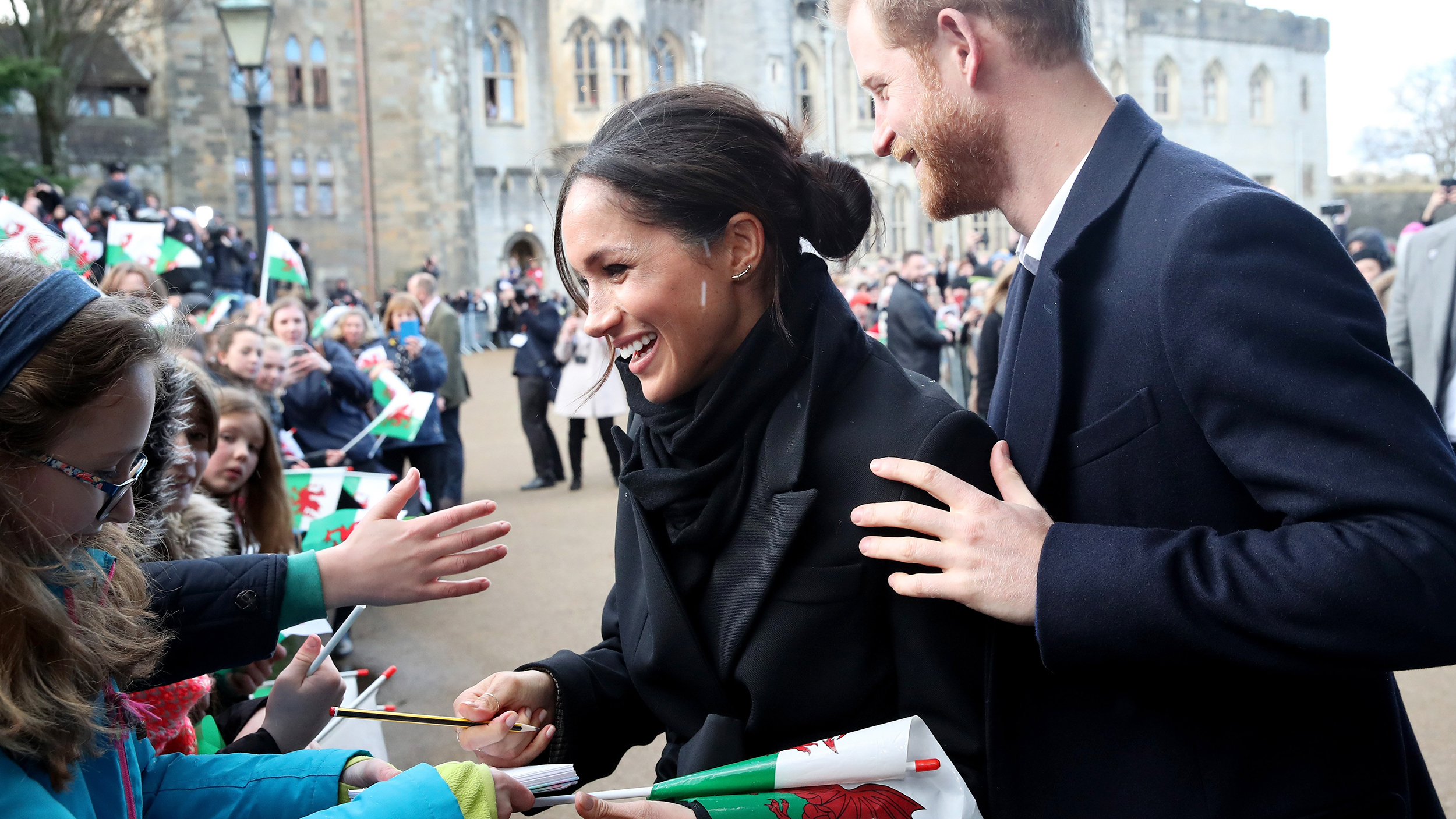 See Prince Harry and Meghan Markle charm crowds during visit to Wales